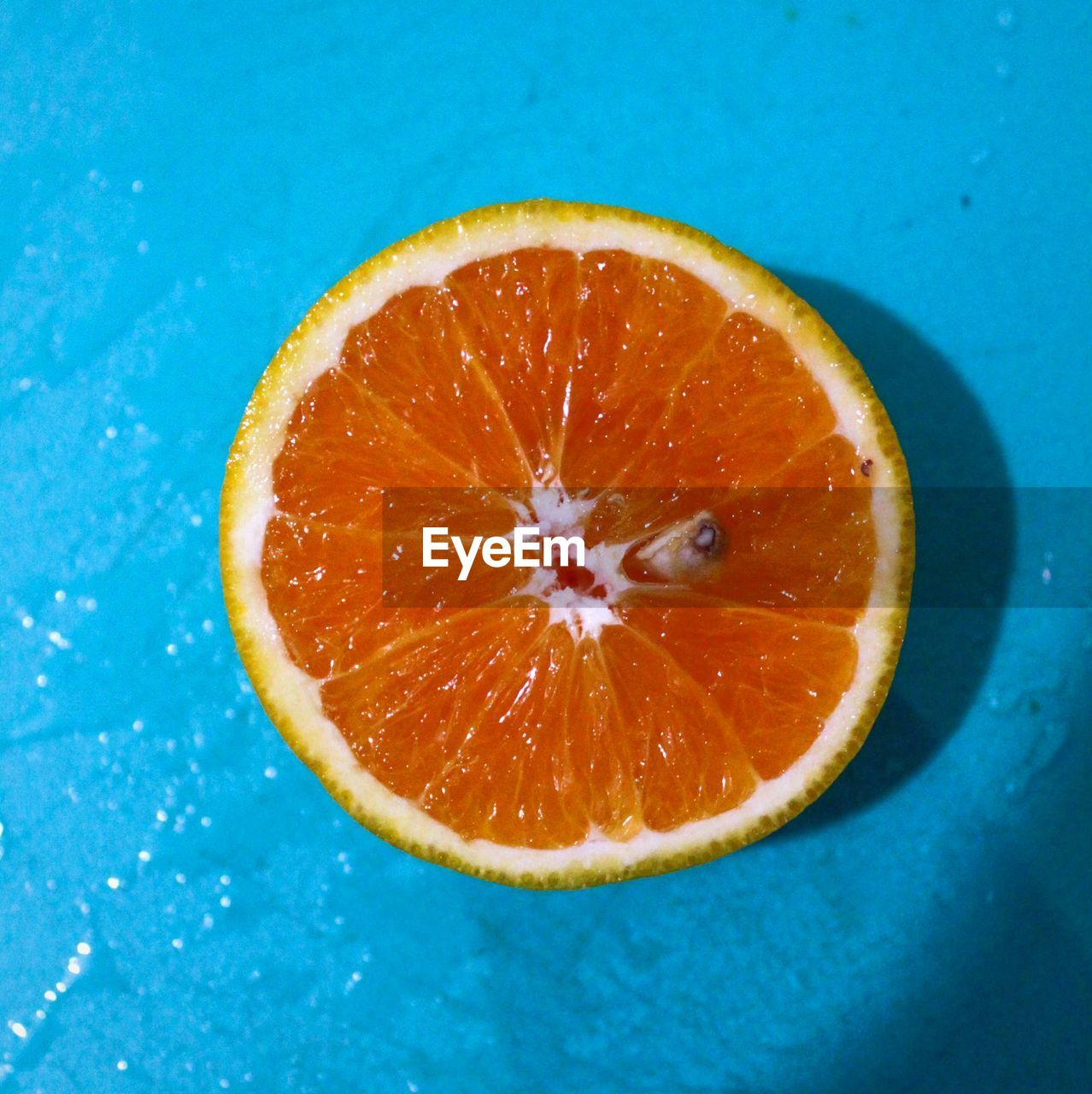 fruit, citrus fruit, healthy eating, food, food and drink, slice, orange color, freshness, wellbeing, orange, cross section, close-up, orange - fruit, studio shot, indoors, colored background, no people, juicy, blue, still life, ripe, blue background, antioxidant, vitamin c
