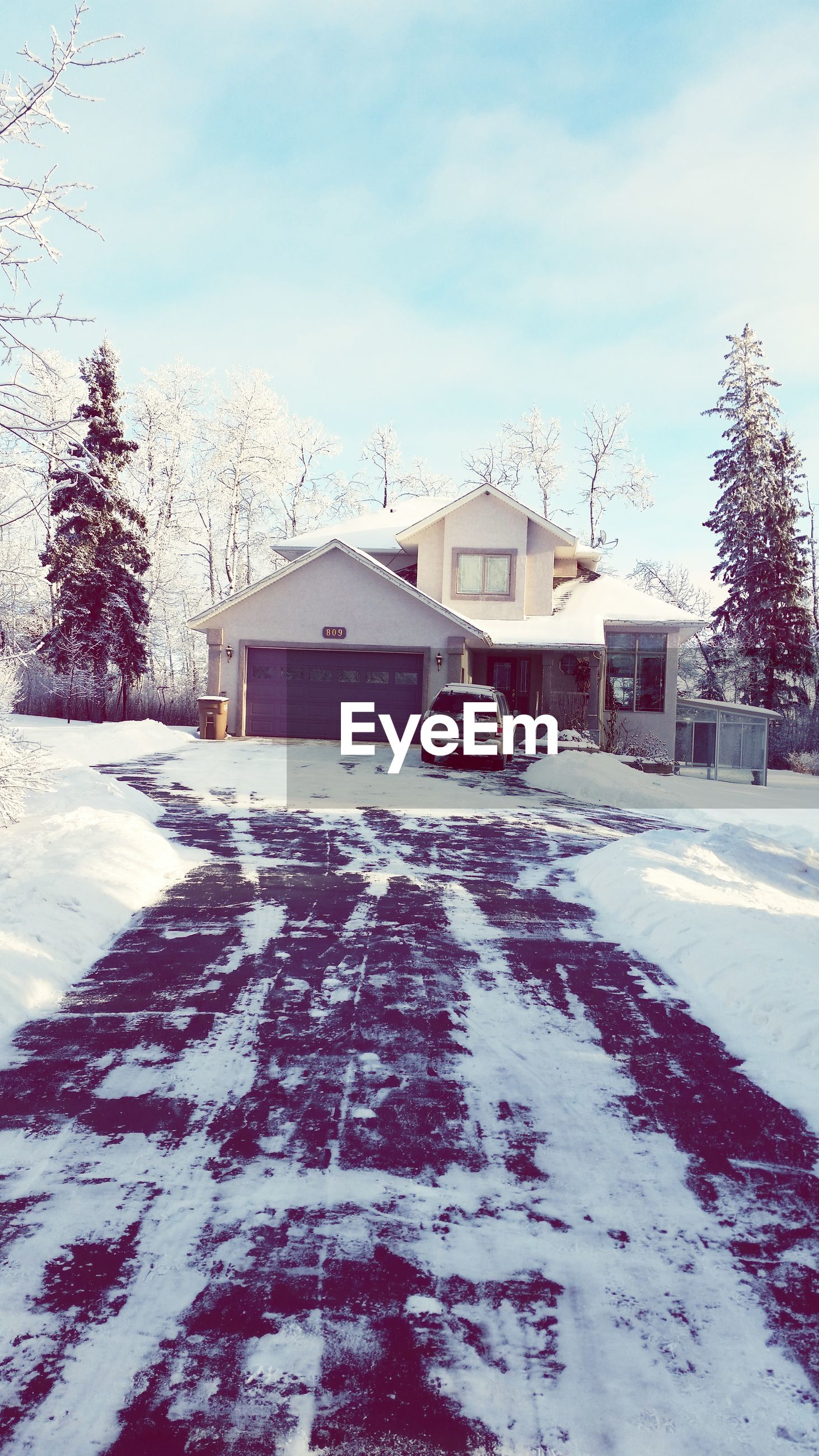 building exterior, architecture, built structure, house, sky, tree, snow, winter, residential structure, residential building, cold temperature, sunlight, day, bare tree, roof, outdoors, weather, no people, nature, season
