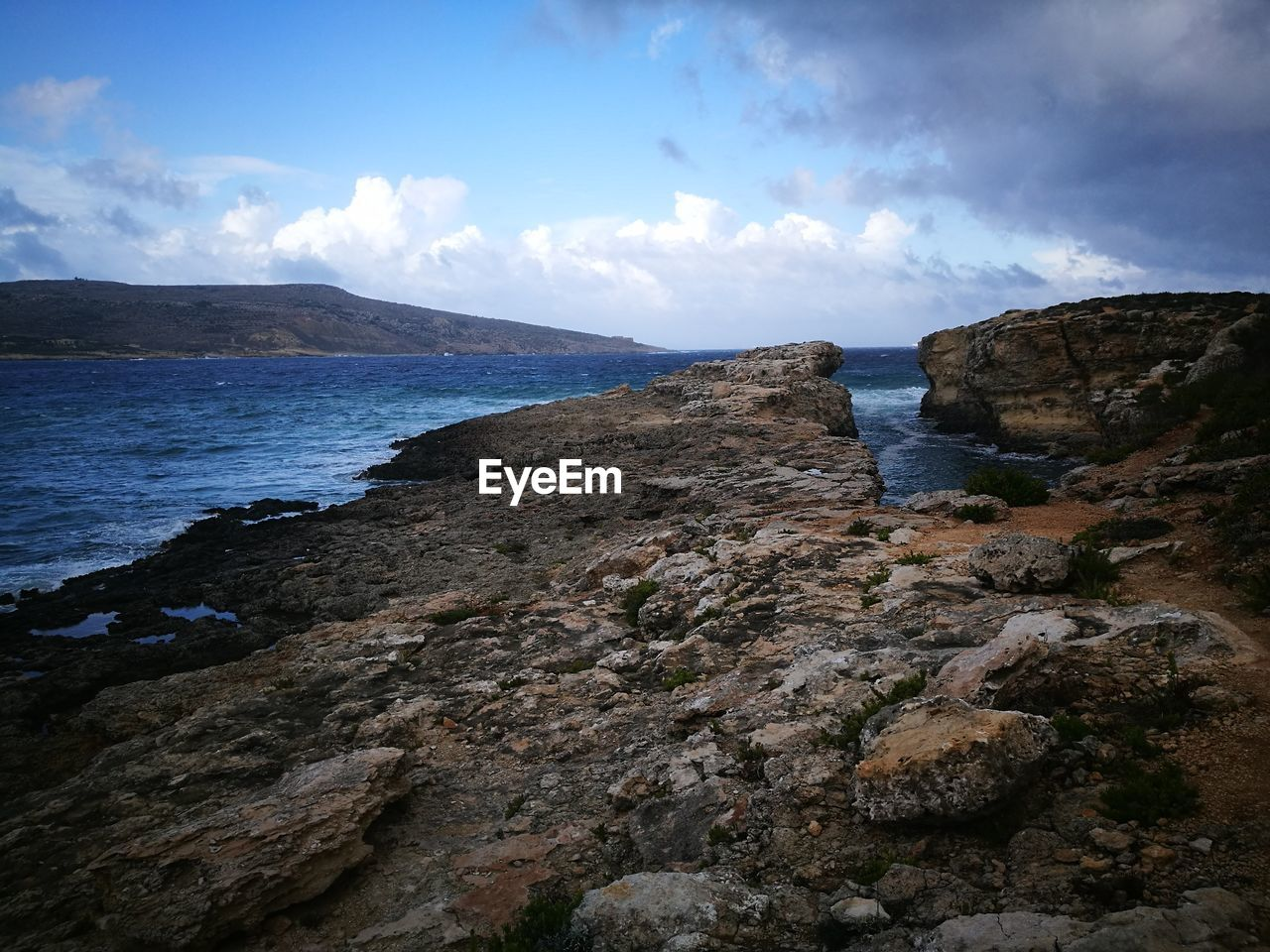 sky, rock, cloud - sky, water, sea, nature, beauty in nature, rock - object, solid, land, beach, mountain, environment, tranquility, scenics - nature, no people, rock formation, outdoors, tranquil scene, rocky coastline