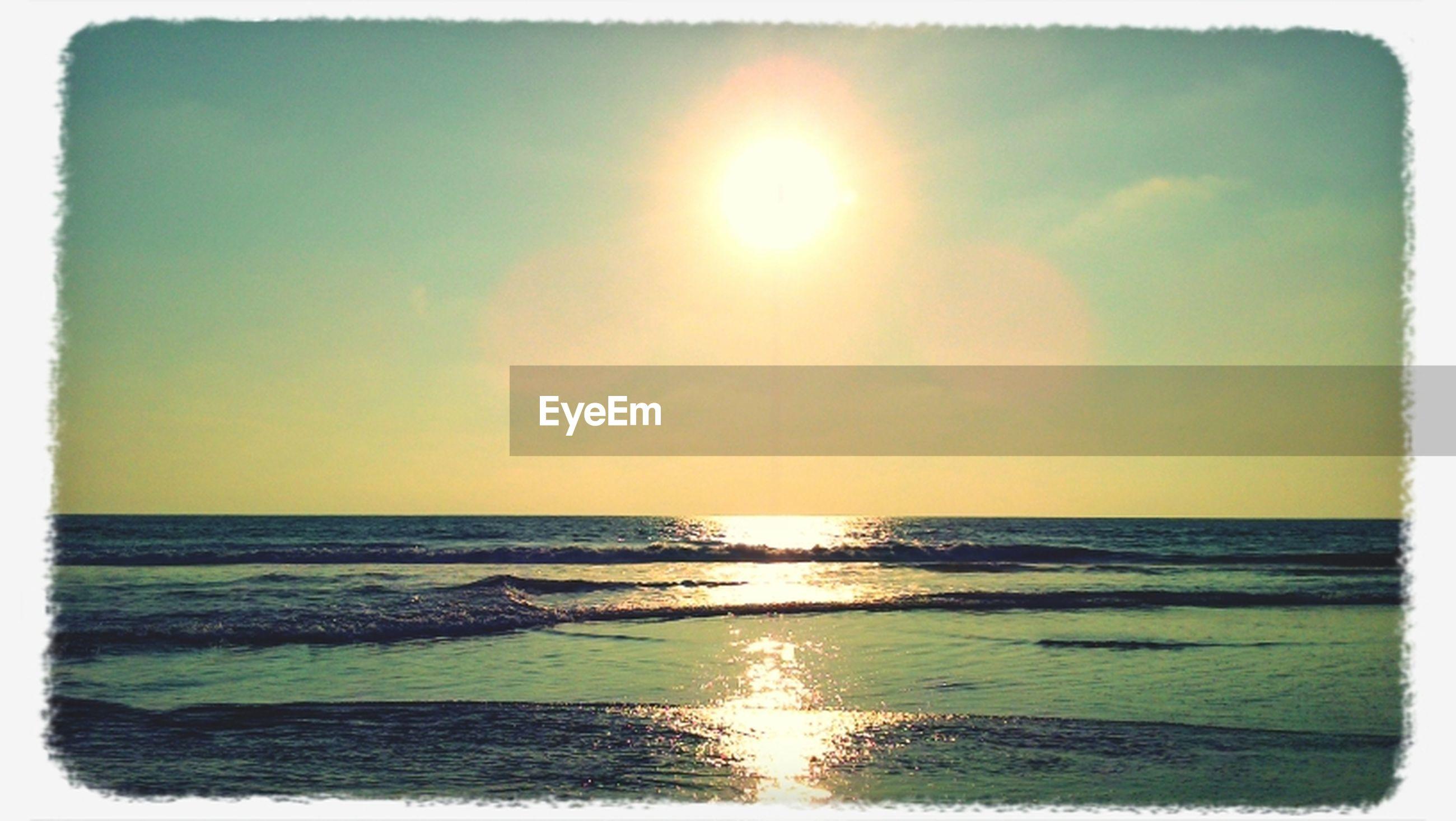 sea, horizon over water, water, transfer print, sun, scenics, tranquil scene, sunset, tranquility, beauty in nature, beach, sky, auto post production filter, reflection, idyllic, shore, nature, sunlight, sunbeam, seascape