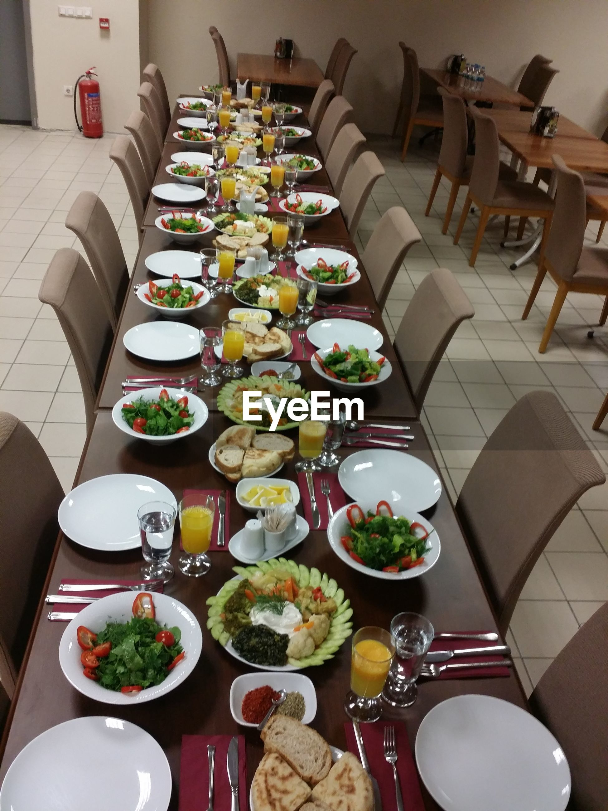 high angle view, table, indoors, dining table, party - social event, food, no people, food and drink, freshness, drink, food styling, ready-to-eat, buffet, day