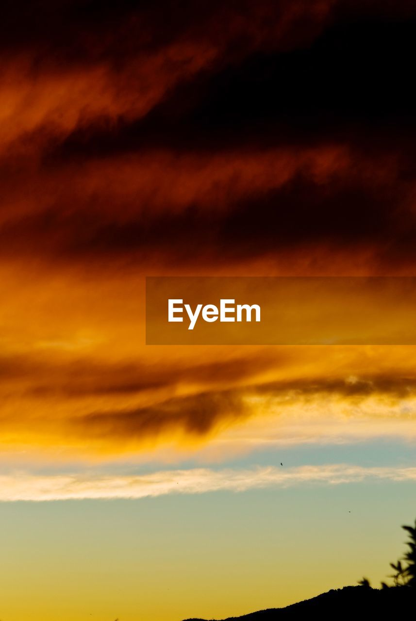 cloud - sky, sky, sunset, beauty in nature, scenics - nature, orange color, tranquil scene, tranquility, idyllic, nature, no people, dramatic sky, low angle view, outdoors, overcast, storm, majestic, awe, backgrounds, meteorology, ominous, romantic sky