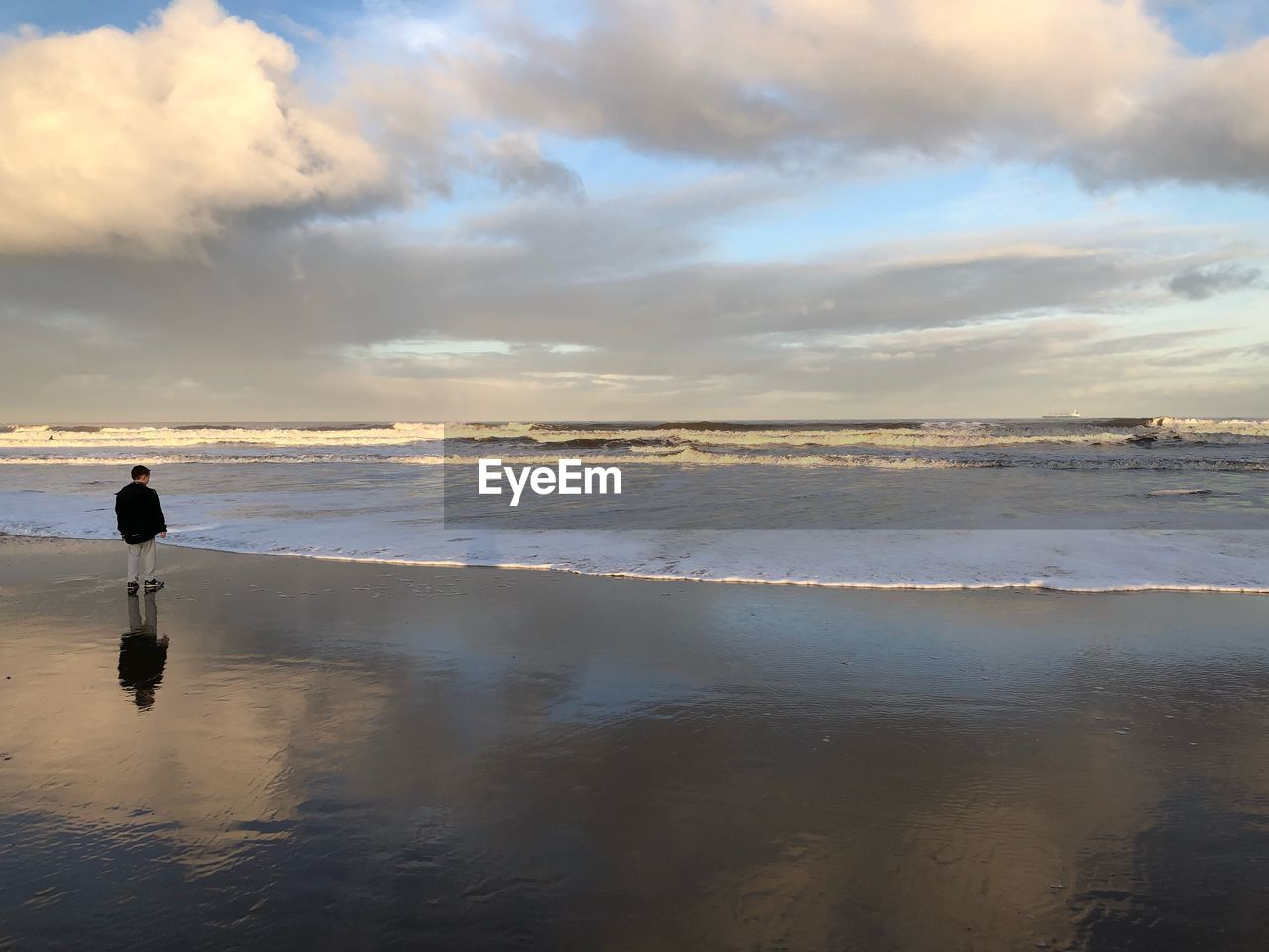 water, sea, cloud - sky, sky, nature, real people, one person, beauty in nature, tranquility, tranquil scene, outdoors, beach, sunset, scenics, horizon over water, standing, leisure activity, day, men, wave, people