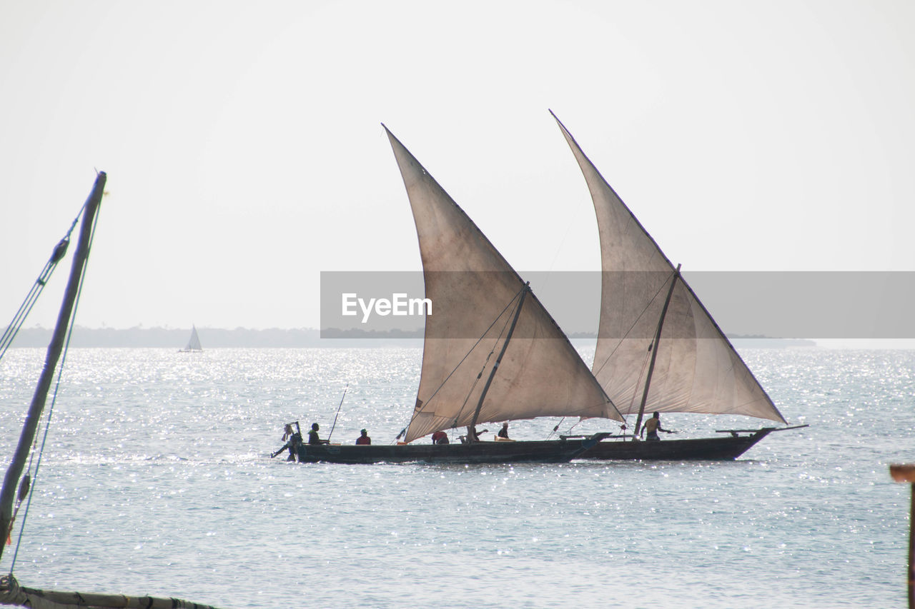 nautical vessel, sea, transportation, sailing, water, mode of transport, outdoors, sailboat, clear sky, day, nature, mast, real people, sky, sailing ship