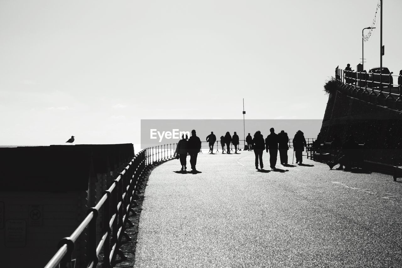 sky, real people, architecture, group of people, built structure, nature, lifestyles, men, crowd, large group of people, women, building exterior, day, travel, copy space, leisure activity, adult, tourism, bridge, outdoors, bridge - man made structure
