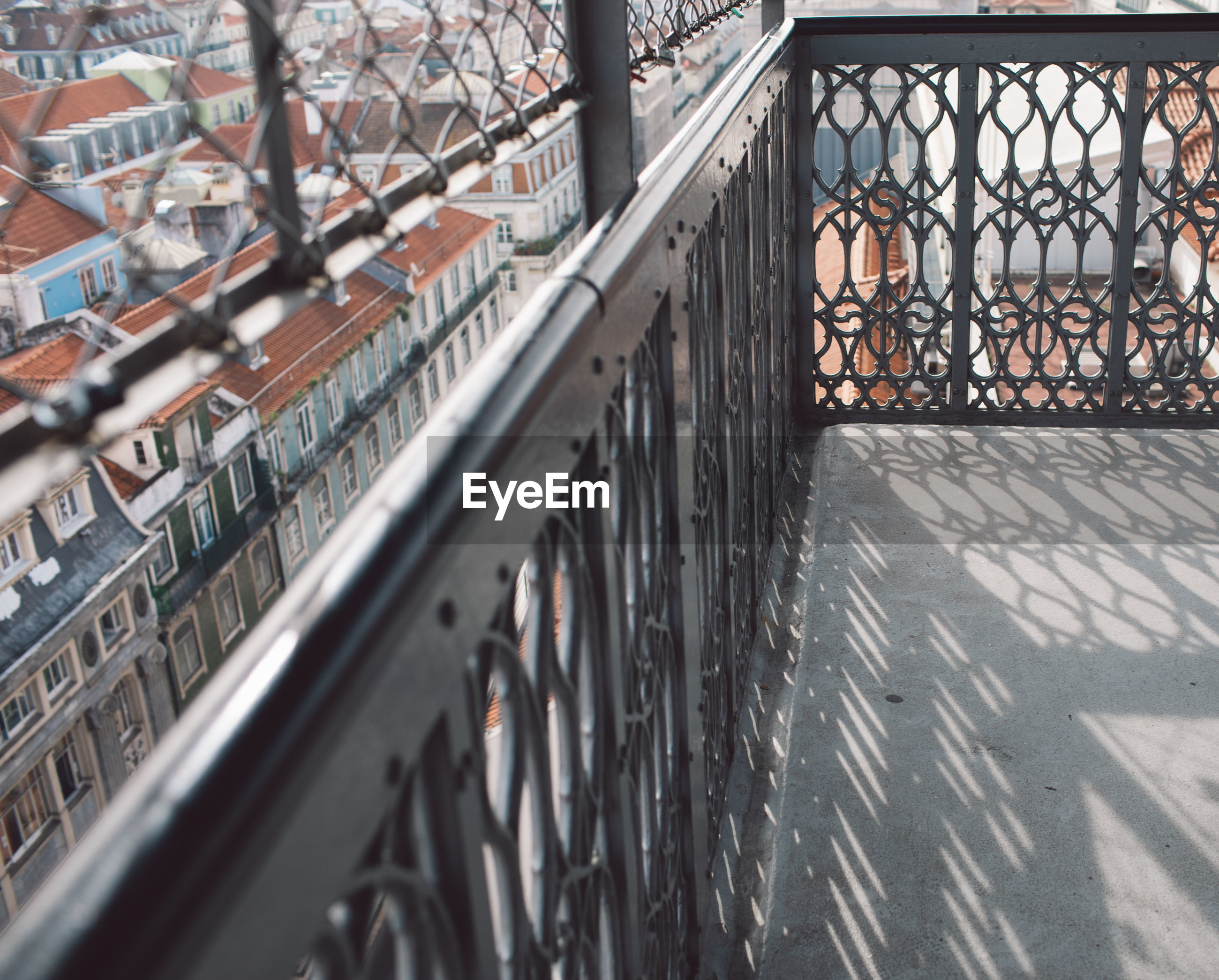 High angle view of railing and buildings in city