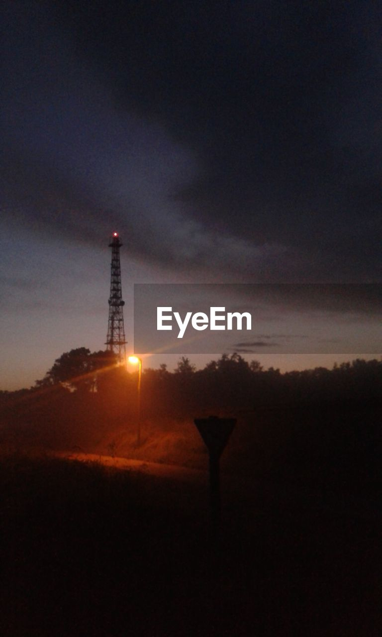 tower, tall - high, night, sky, nature, illuminated, dusk, sunset, silhouette, architecture, no people, built structure, low angle view, outdoors, beauty in nature, tranquility, communication, landscape, lighthouse, scenics, electricity, electricity pylon, technology, astronomy, drilling rig