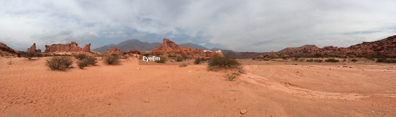 scenics - nature, tranquil scene, sky, cloud - sky, non-urban scene, tranquility, landscape, environment, beauty in nature, climate, mountain, desert, arid climate, remote, rock formation, land, no people, nature, day, rock, mountain range, formation, semi-arid