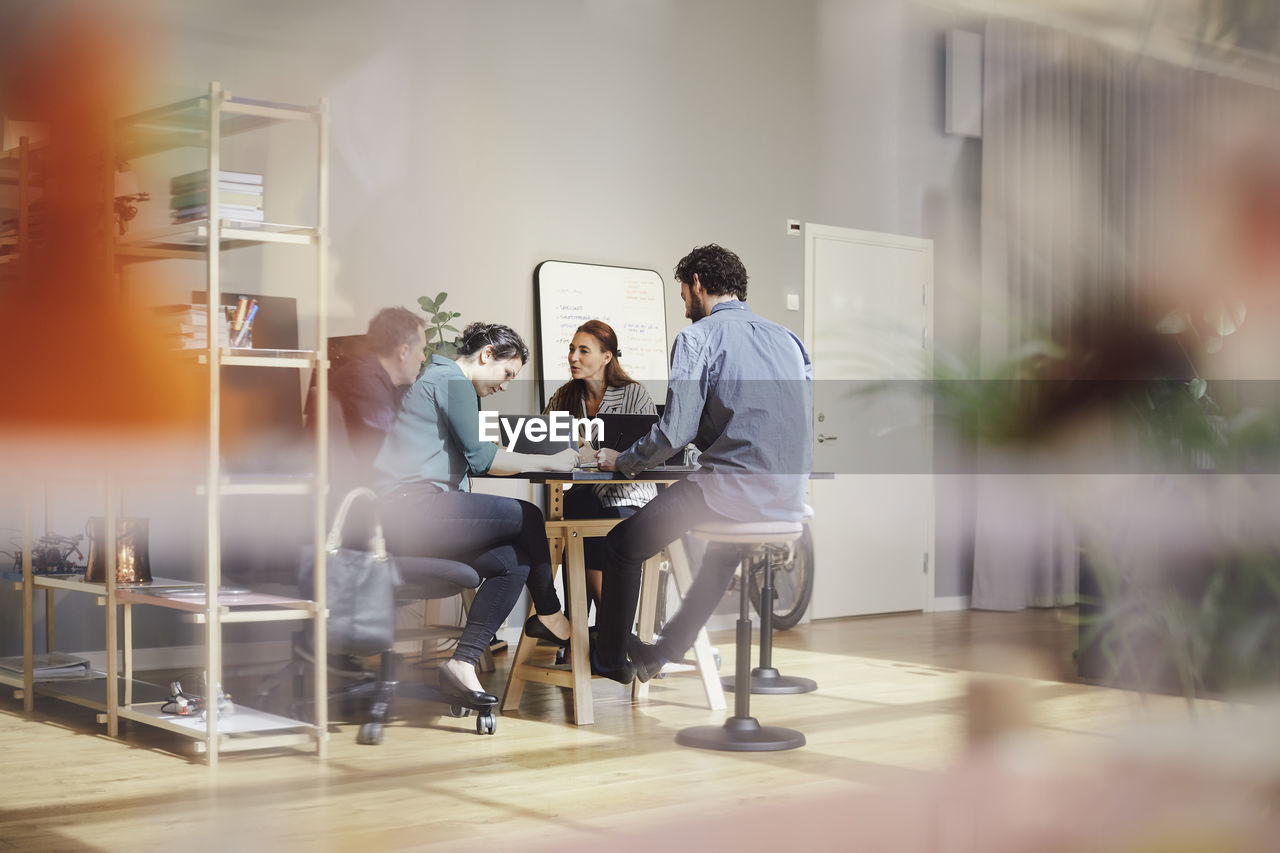 table, men, group of people, business person, colleague, males, business, meeting, businessman, office, corporate business, business meeting, adult, communication, sitting, women, teamwork, cooperation, discussion, businesswoman, coworker, planning, brainstorming, mature men