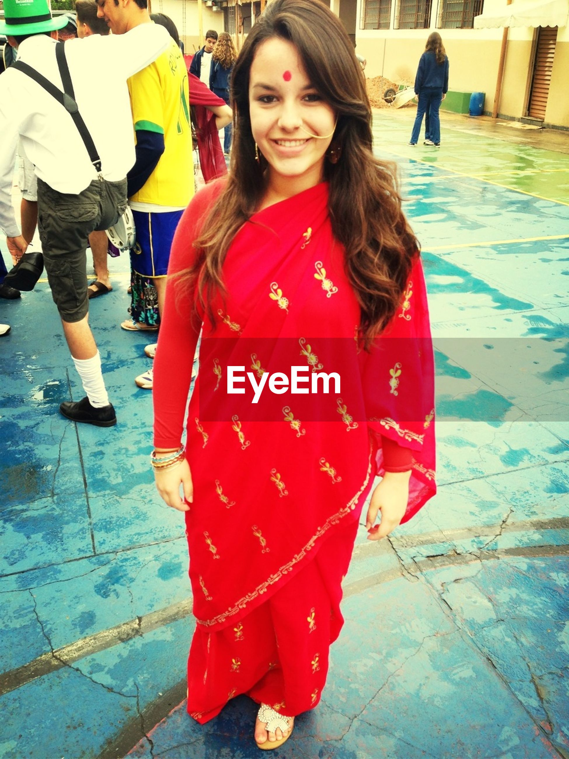 lifestyles, casual clothing, leisure activity, red, standing, front view, person, full length, looking at camera, portrait, smiling, young women, traditional clothing, girls, happiness, young adult, holding
