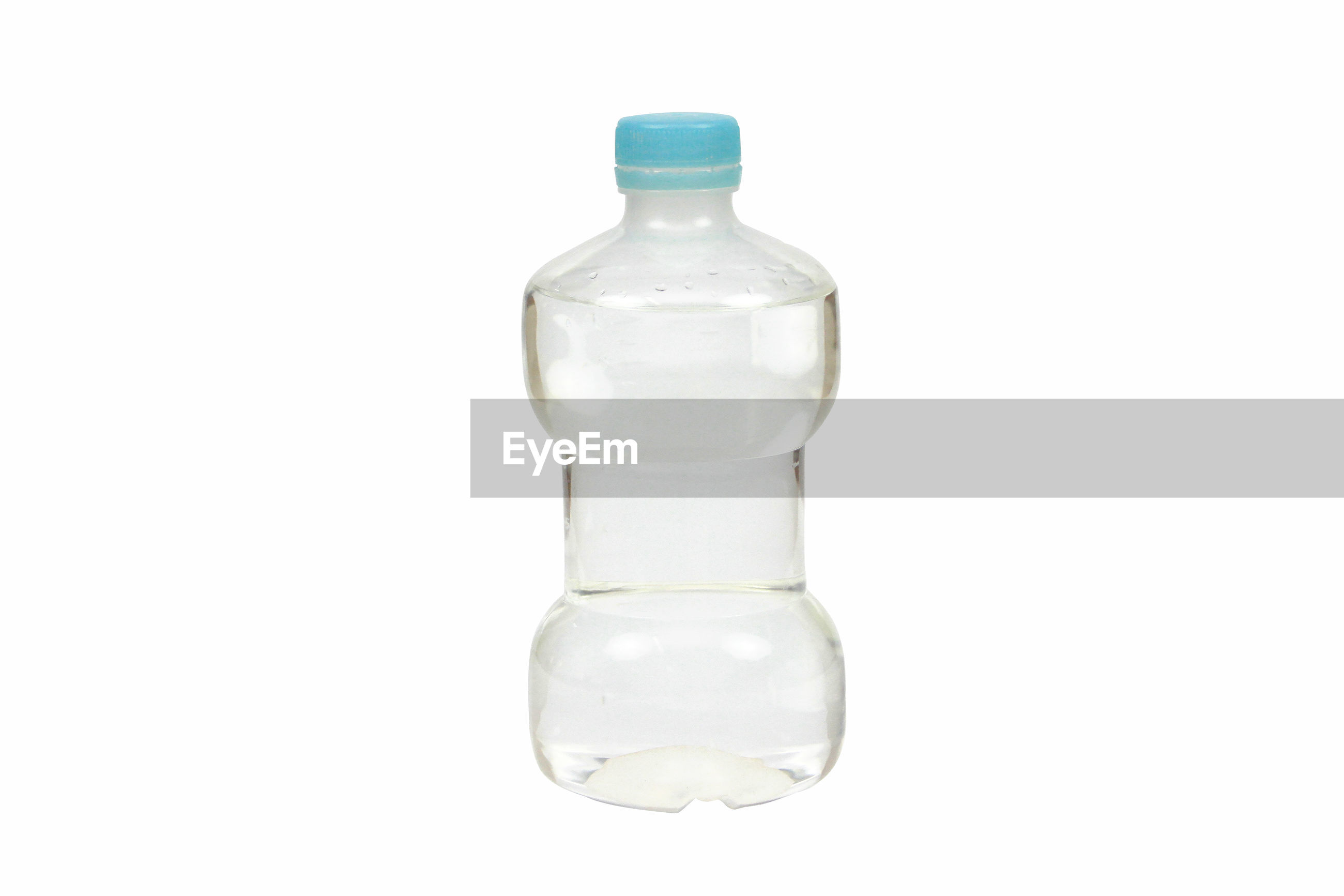 Close-up of water bottle on white background