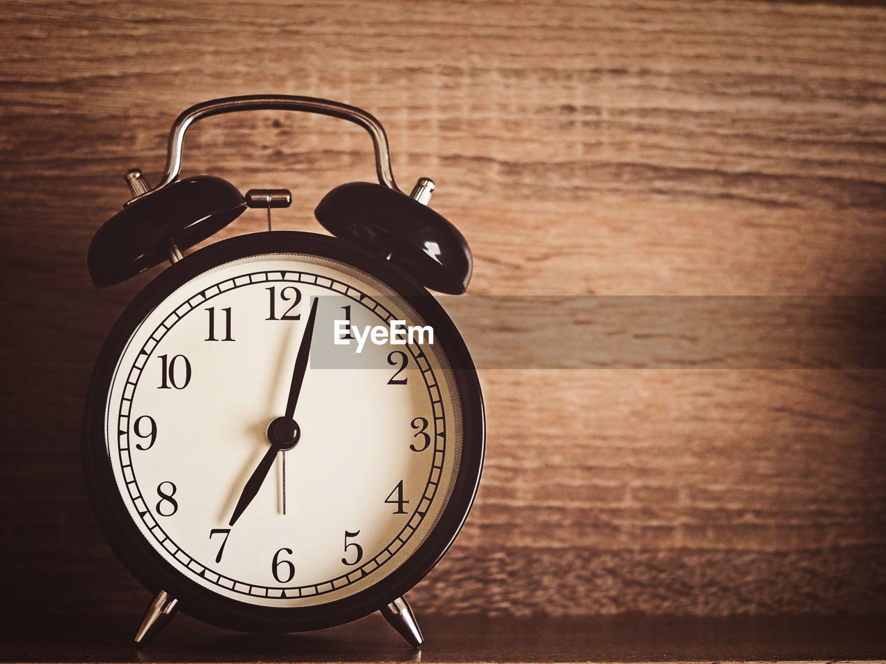time, clock, alarm clock, number, table, indoors, no people, close-up, minute hand, accuracy, wood - material, focus on foreground, still life, clock face, shape, single object, clock hand, retro styled, deadline, wood grain, personal accessory