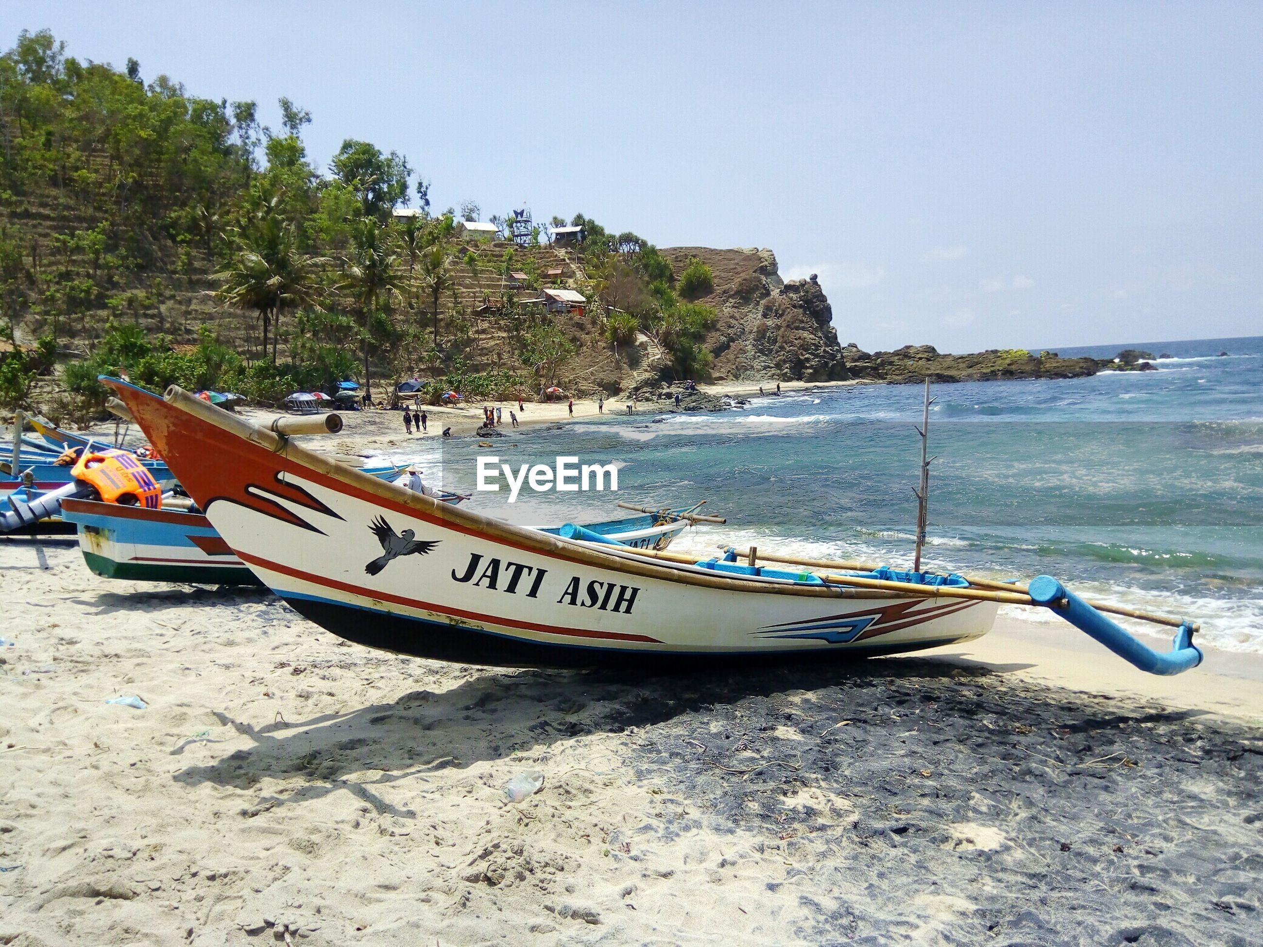 VIEW OF BOATS MOORED ON BEACH