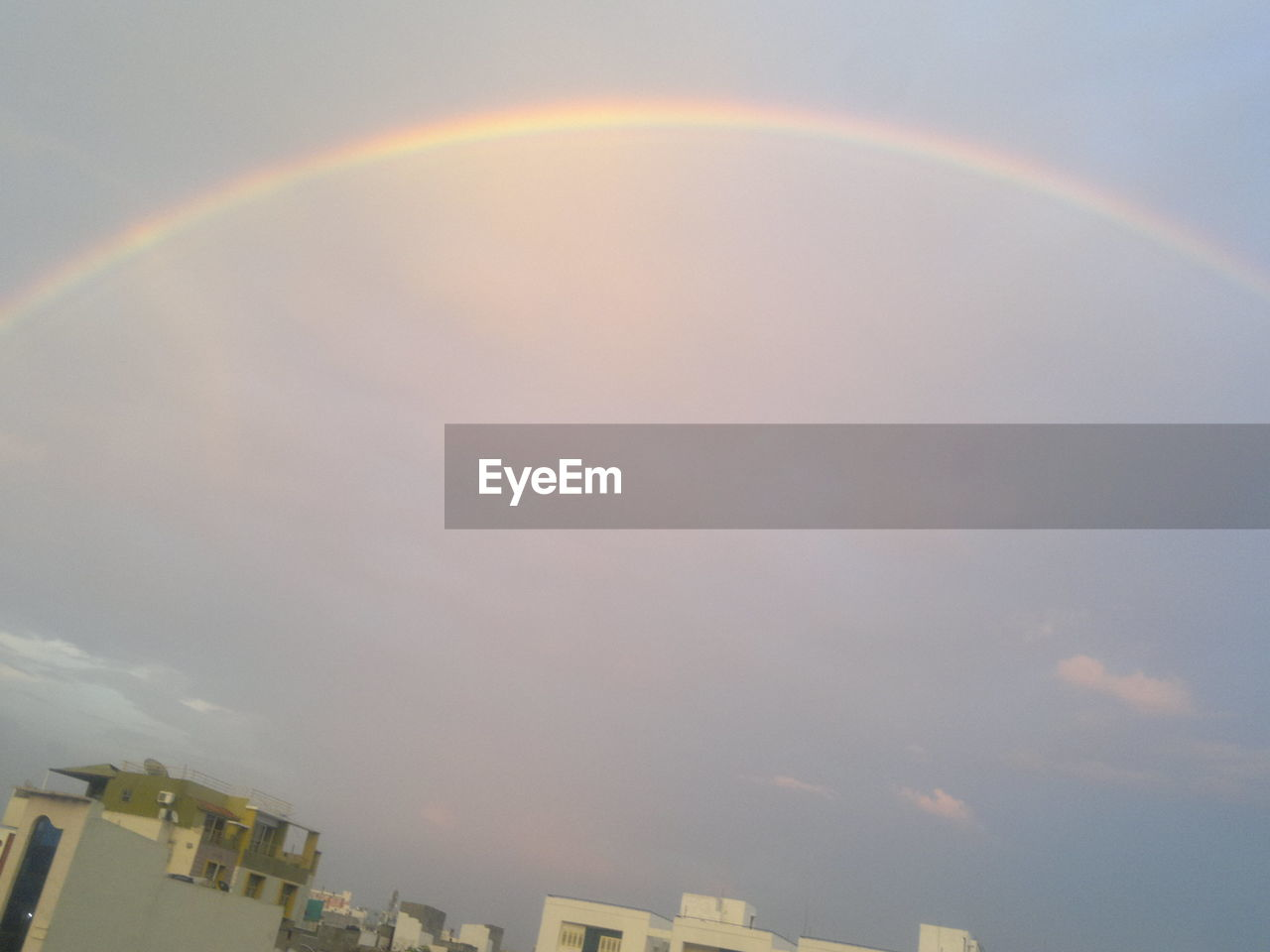 rainbow, double rainbow, building exterior, sky, beauty in nature, no people, outdoors, nature, architecture, built structure, day, cloud - sky, scenics, city