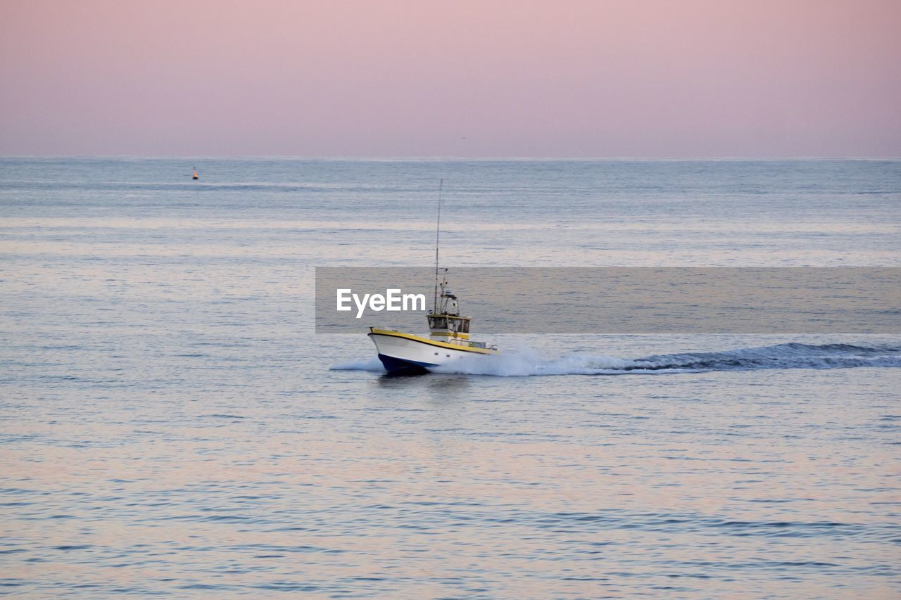sea, water, mode of transportation, transportation, nautical vessel, sky, horizon over water, waterfront, horizon, scenics - nature, beauty in nature, sunset, sailing, nature, motion, travel, no people, tranquil scene, tranquility, outdoors, fishing industry, fishing boat, sailboat