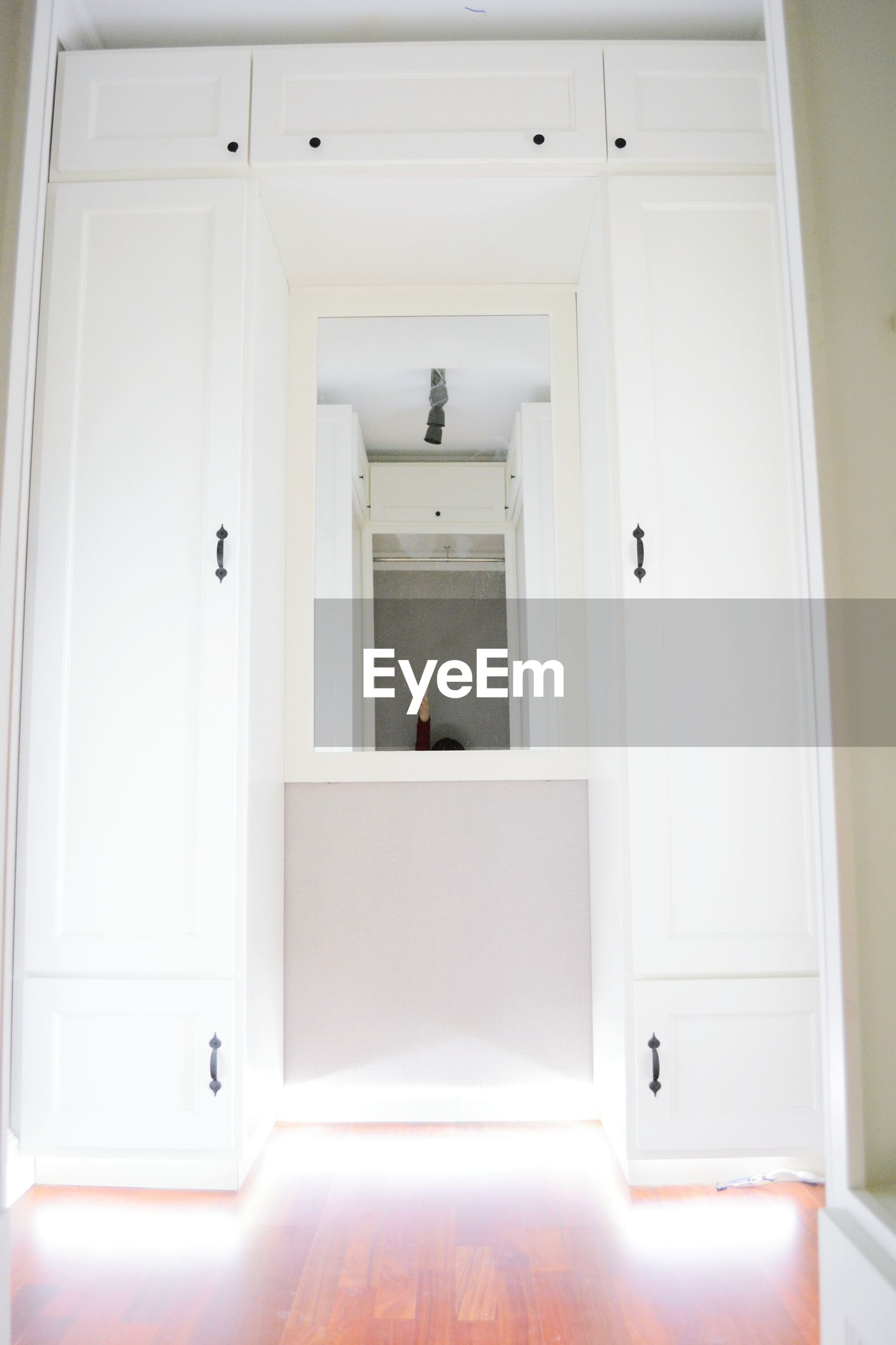 indoors, door, built structure, architecture, window, closed, house, doorway, entrance, wall, home interior, wall - building feature, no people, domestic room, white color, open, safety, security, day, wood - material