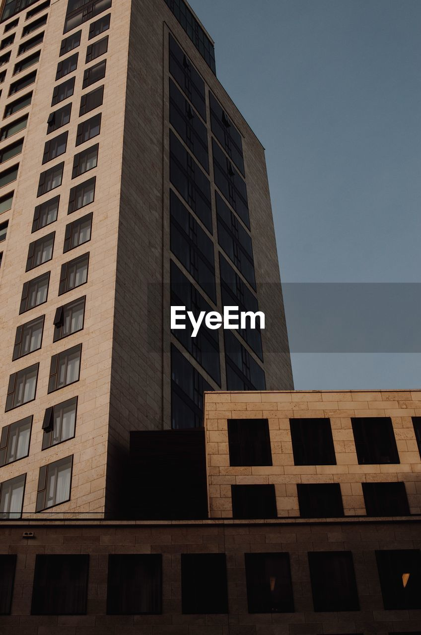 architecture, built structure, building exterior, low angle view, window, building, sky, no people, city, modern, nature, office, office building exterior, clear sky, glass - material, outdoors, day, in a row, tall - high, sunlight, skyscraper