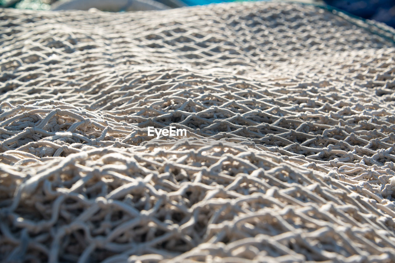 selective focus, pattern, no people, close-up, backgrounds, textile, full frame, textured, day, still life, large group of objects, indoors, metal, fishing industry, beach, nature, high angle view, industry, sunlight, silver colored