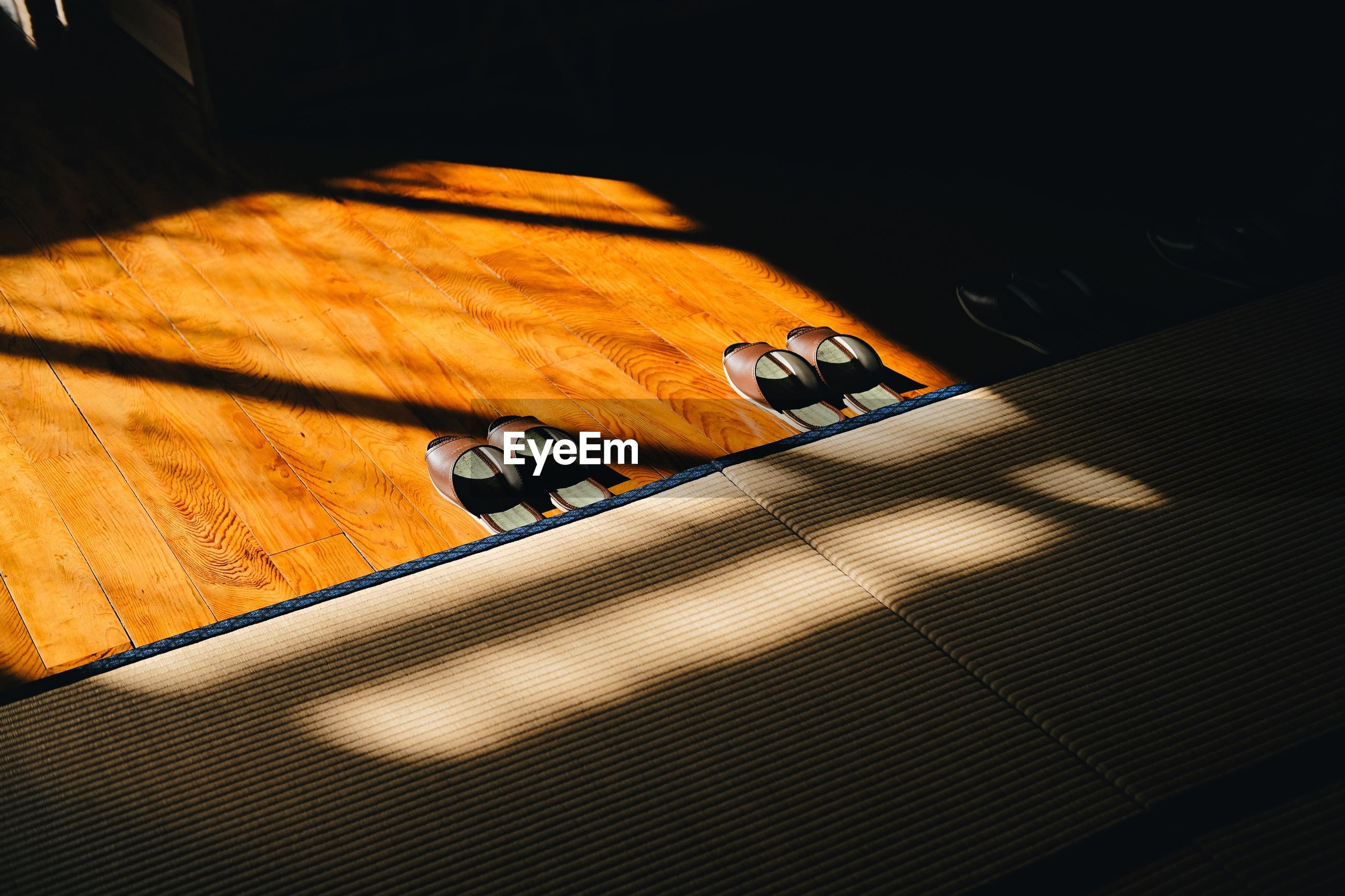 table, indoors, high angle view, no people, wood - material, shadow, close-up, technology, day