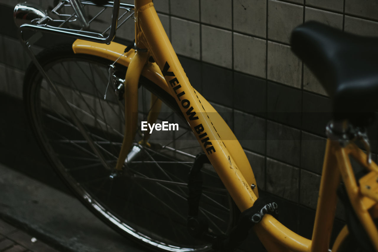 High angle view of yellow bicycle