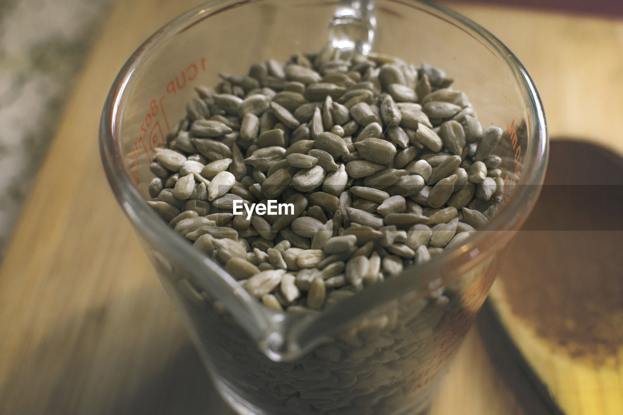 High angle view of sunflower seeds in container on table
