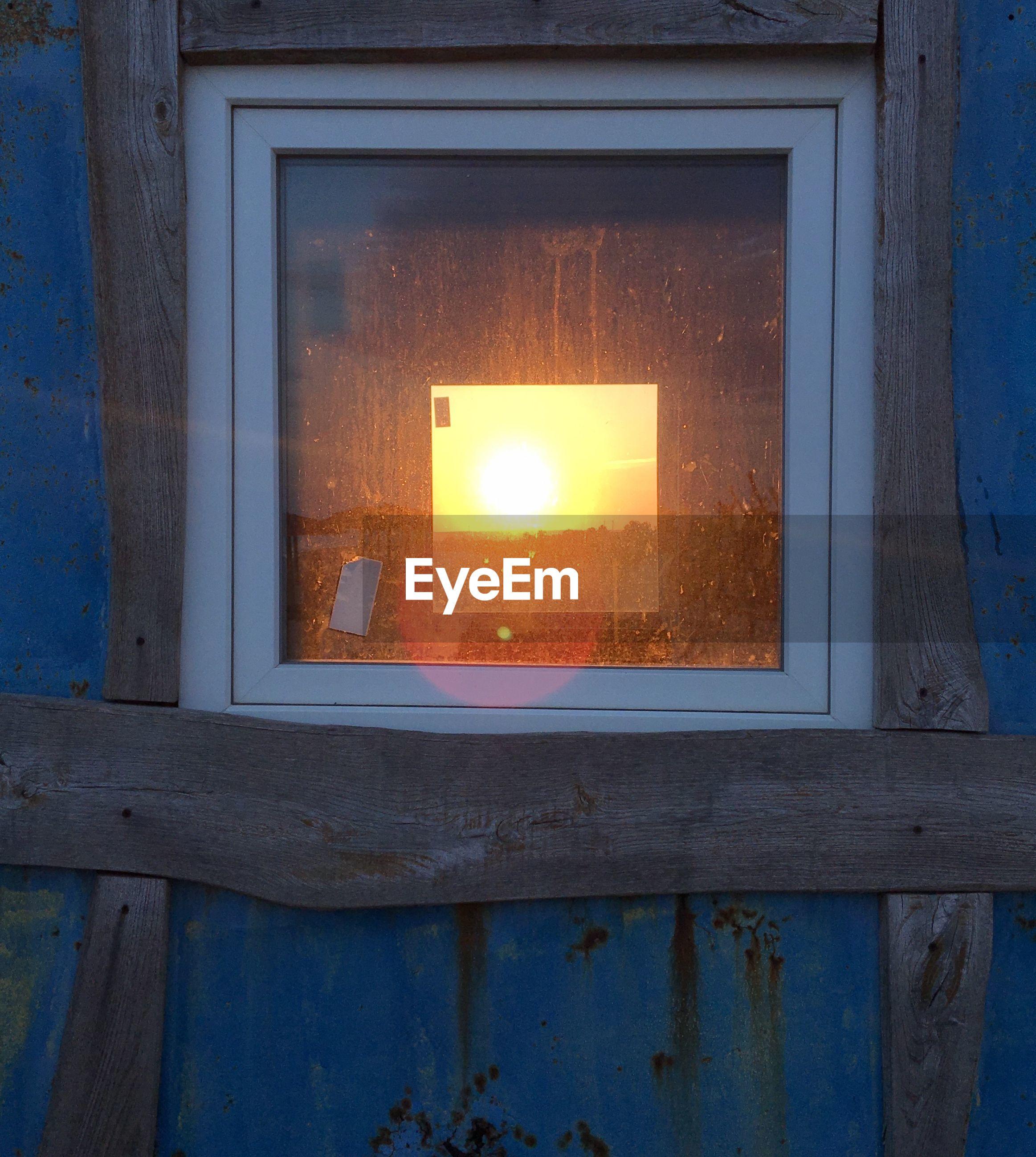 CLOSE-UP OF WINDOW IN ILLUMINATED BUILDING