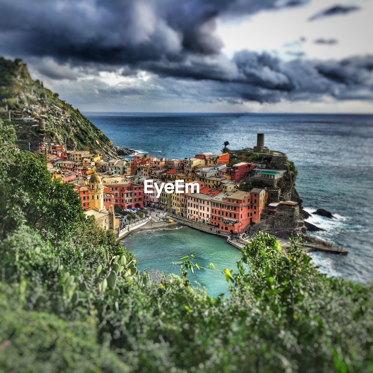 High angle view of buildings at cinque terre by sea against sky