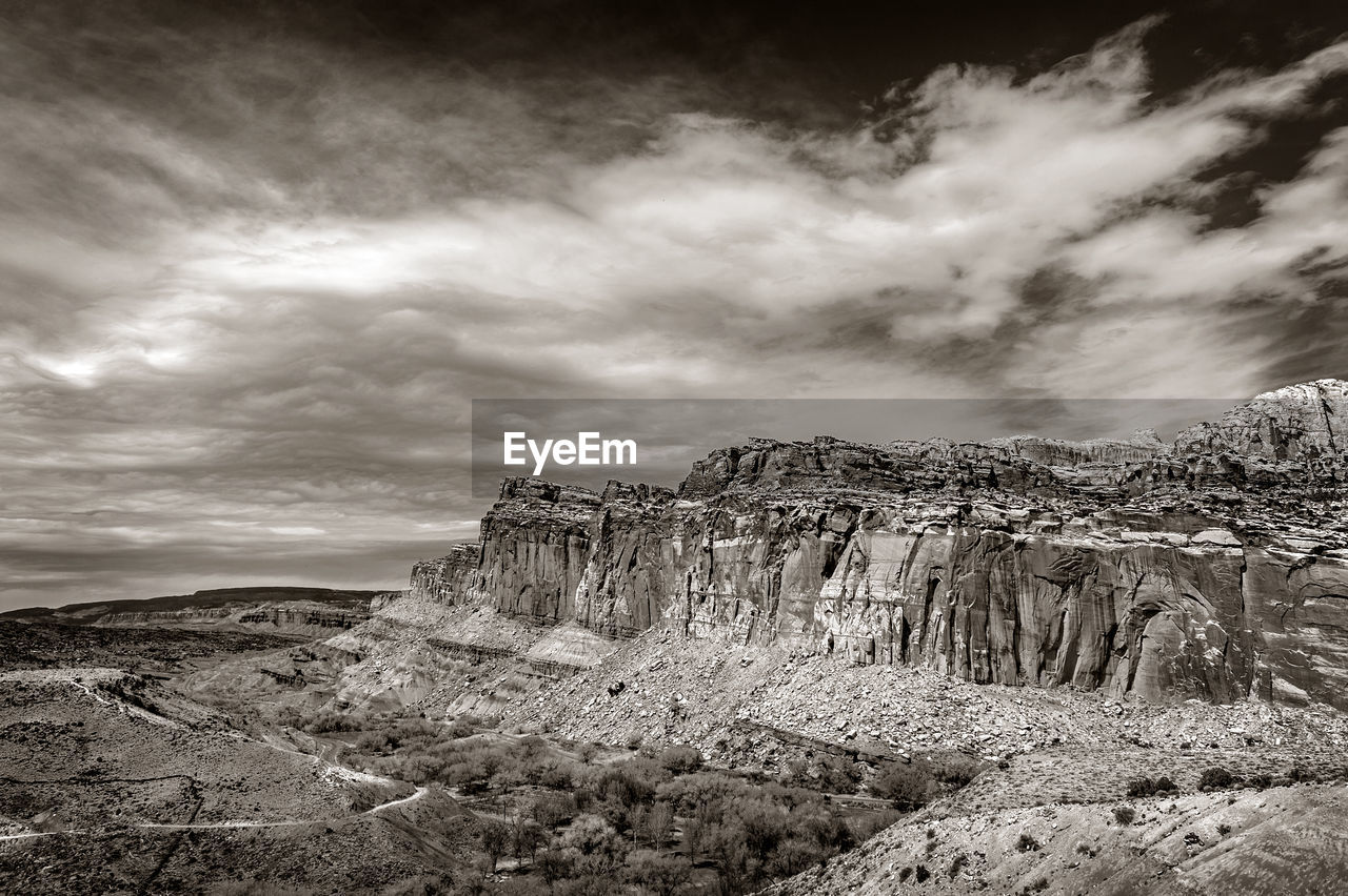 sky, cloud - sky, tranquil scene, tranquility, rock, scenics - nature, beauty in nature, environment, rock formation, nature, non-urban scene, rock - object, no people, solid, mountain, landscape, remote, day, idyllic, formation, outdoors, arid climate, climate, eroded
