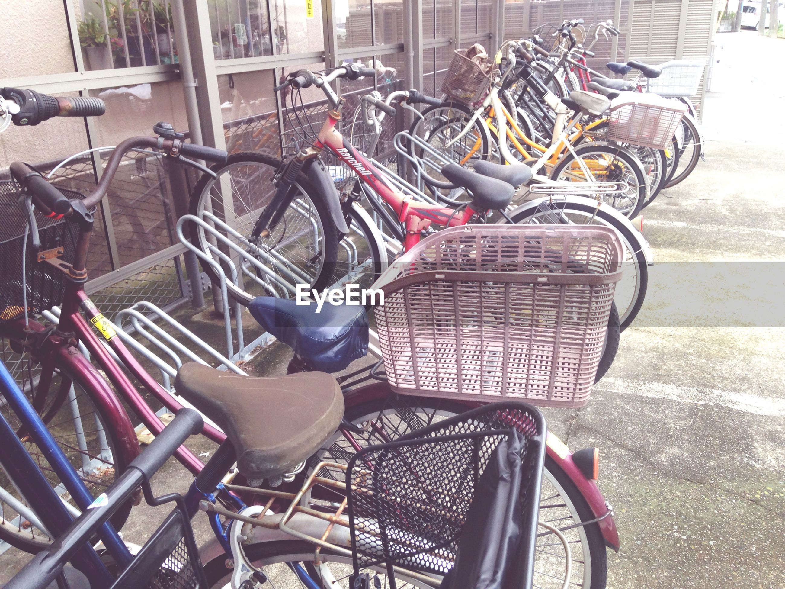bicycle, land vehicle, transportation, mode of transport, stationary, parking, sunlight, parked, chair, high angle view, street, outdoors, day, sidewalk, shadow, metal, absence, parking lot, city, no people