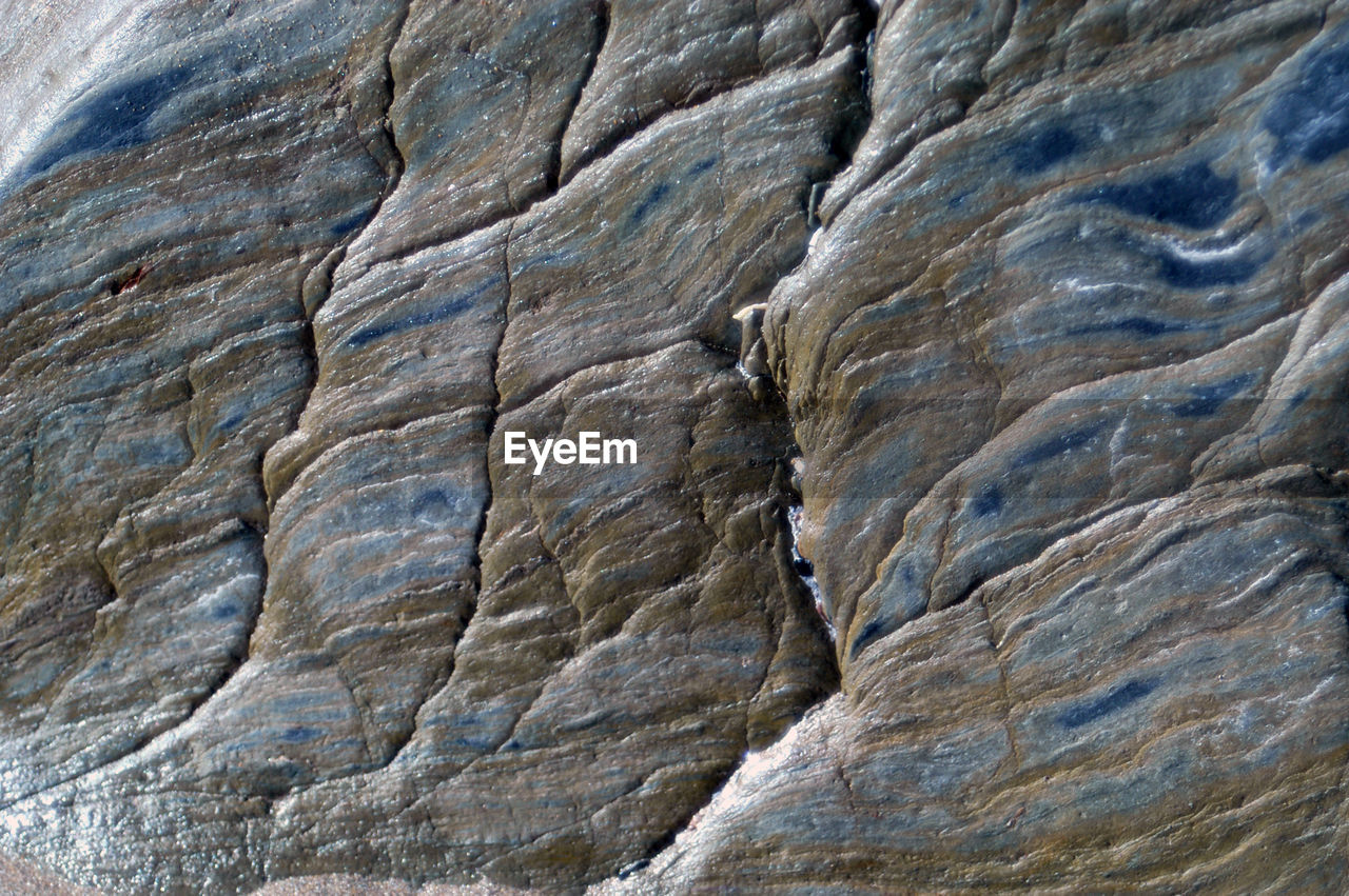 rock - object, rock, solid, rock formation, full frame, backgrounds, textured, no people, close-up, nature, geology, pattern, rough, natural pattern, day, eroded, non-urban scene, outdoors, sandstone, beauty in nature, abstract