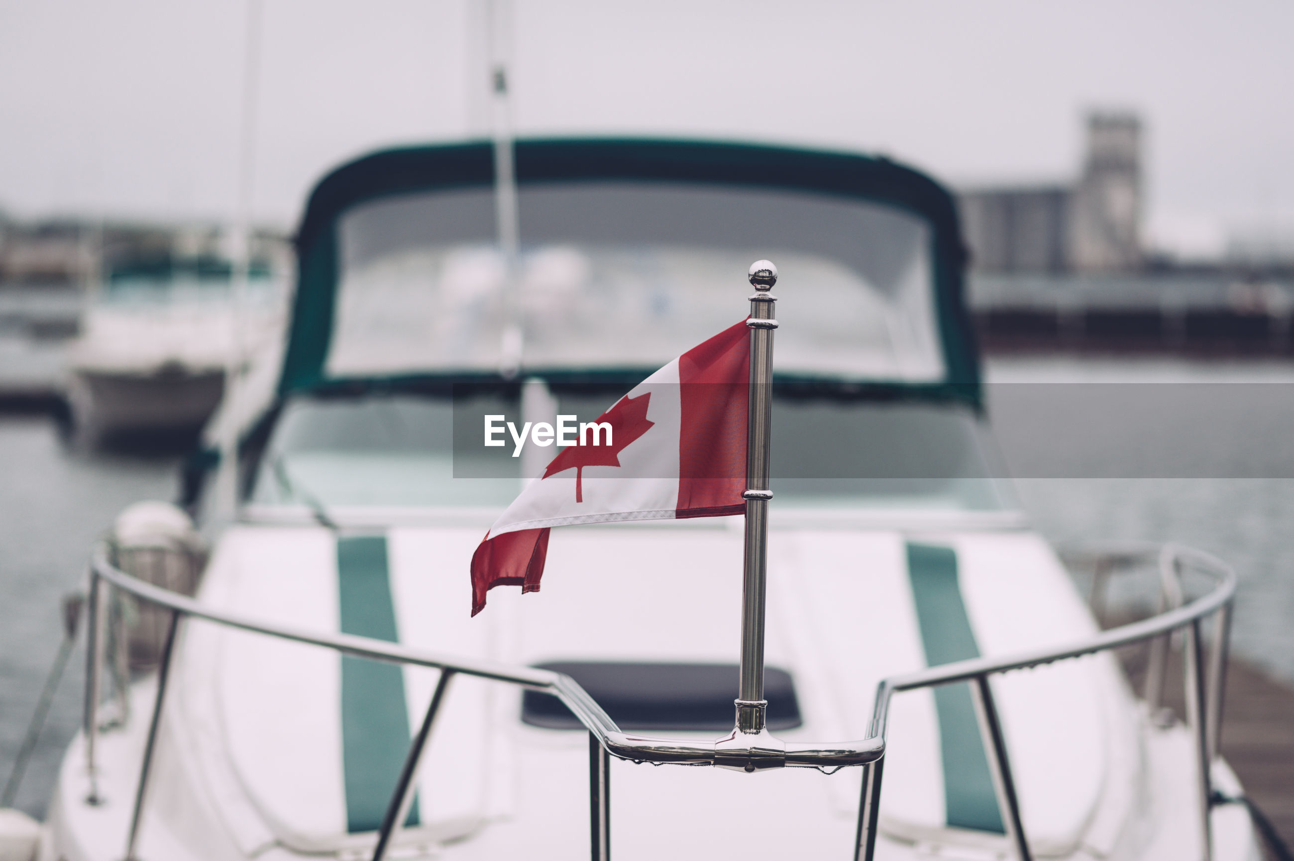 Canadian flag on railing of boat
