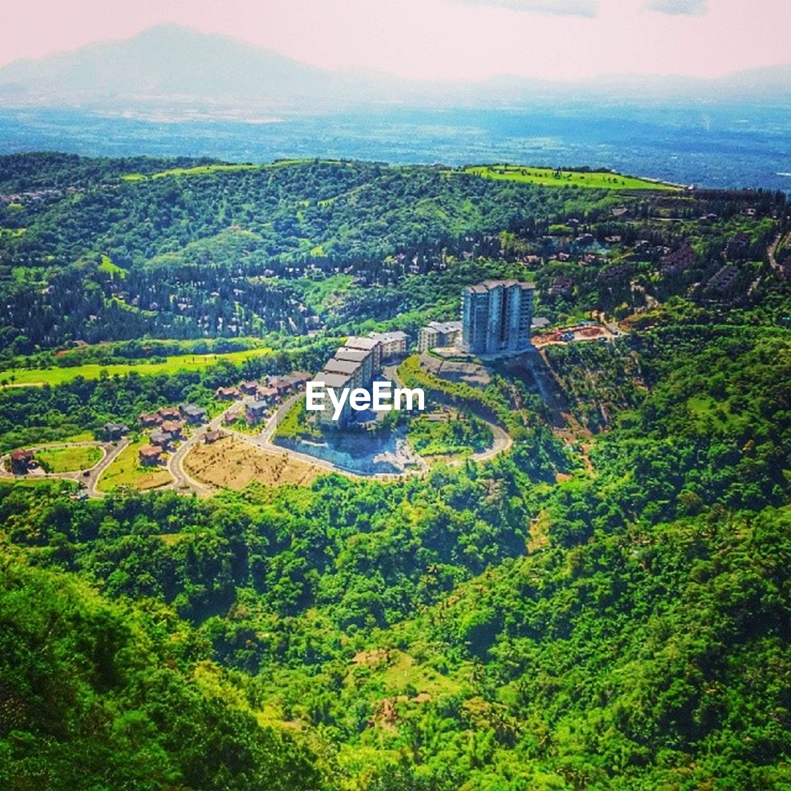 landscape, tree, high angle view, green color, mountain, scenics, building exterior, built structure, architecture, nature, beauty in nature, agriculture, tranquil scene, tranquility, rural scene, field, growth, aerial view, lush foliage, hill