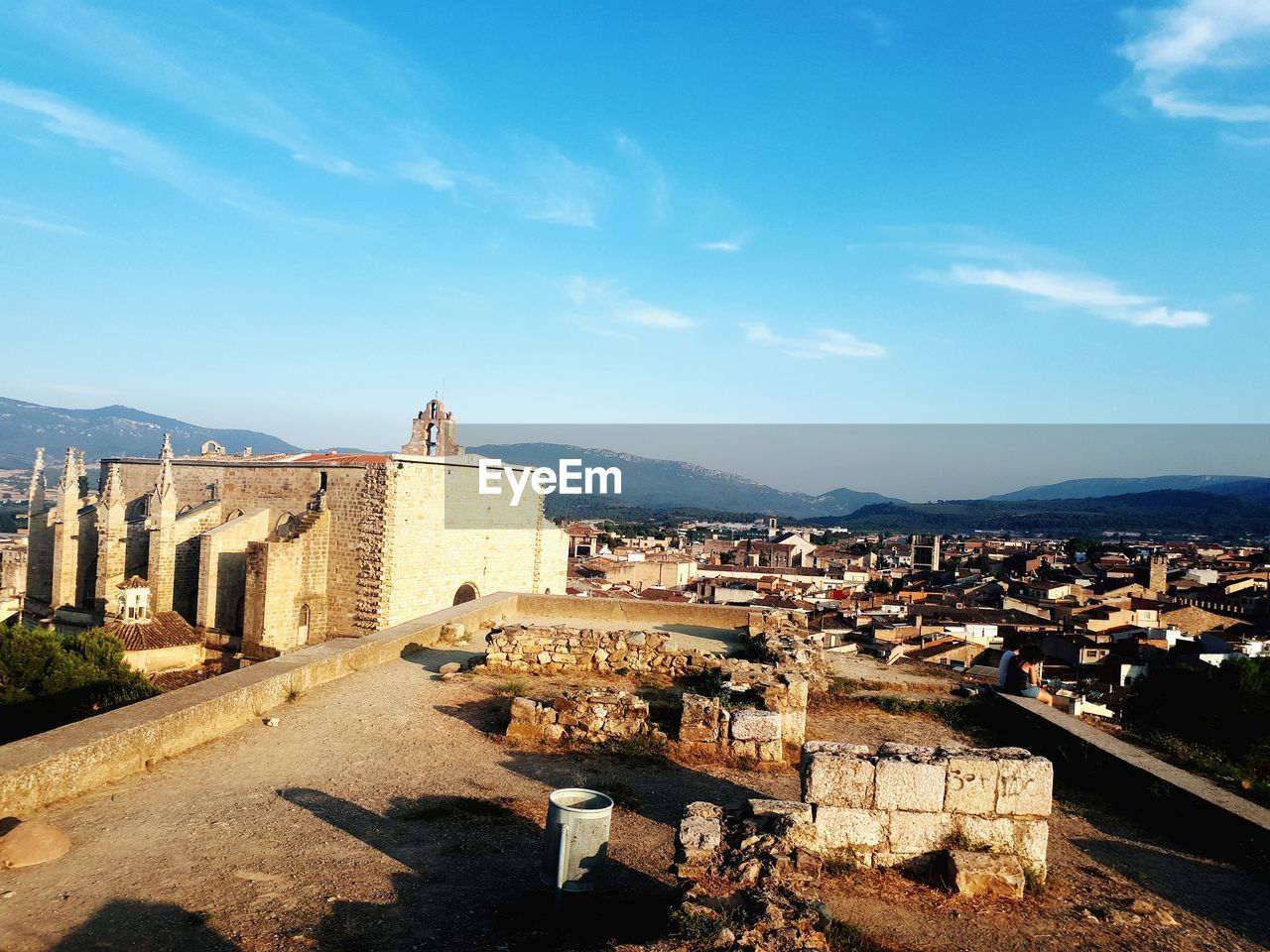 architecture, building exterior, built structure, sky, history, building, city, the past, mountain, nature, day, travel destinations, fort, residential district, no people, sunlight, old, cloud - sky, blue, ancient, cityscape, outdoors, townscape