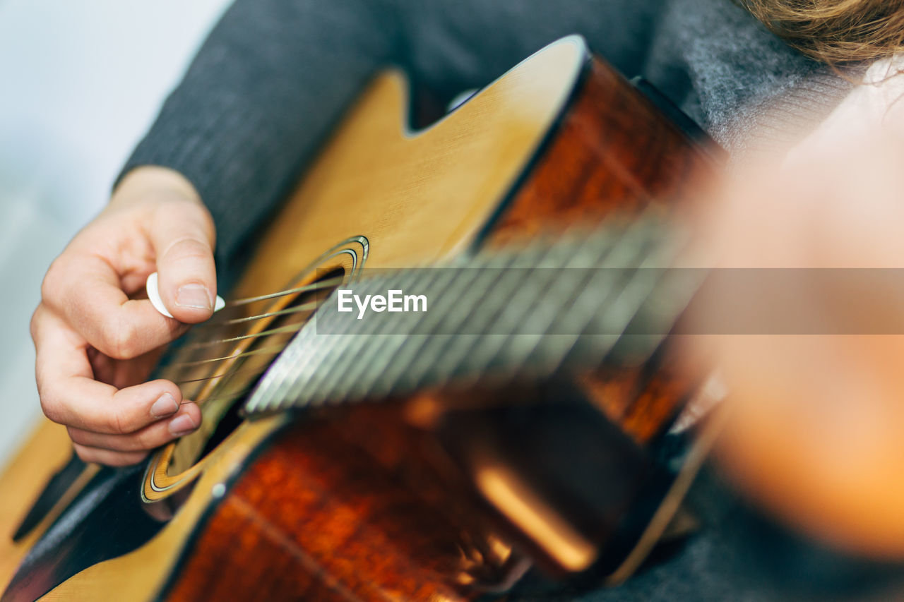 Detail Shot Of Hands Playing The Guitar