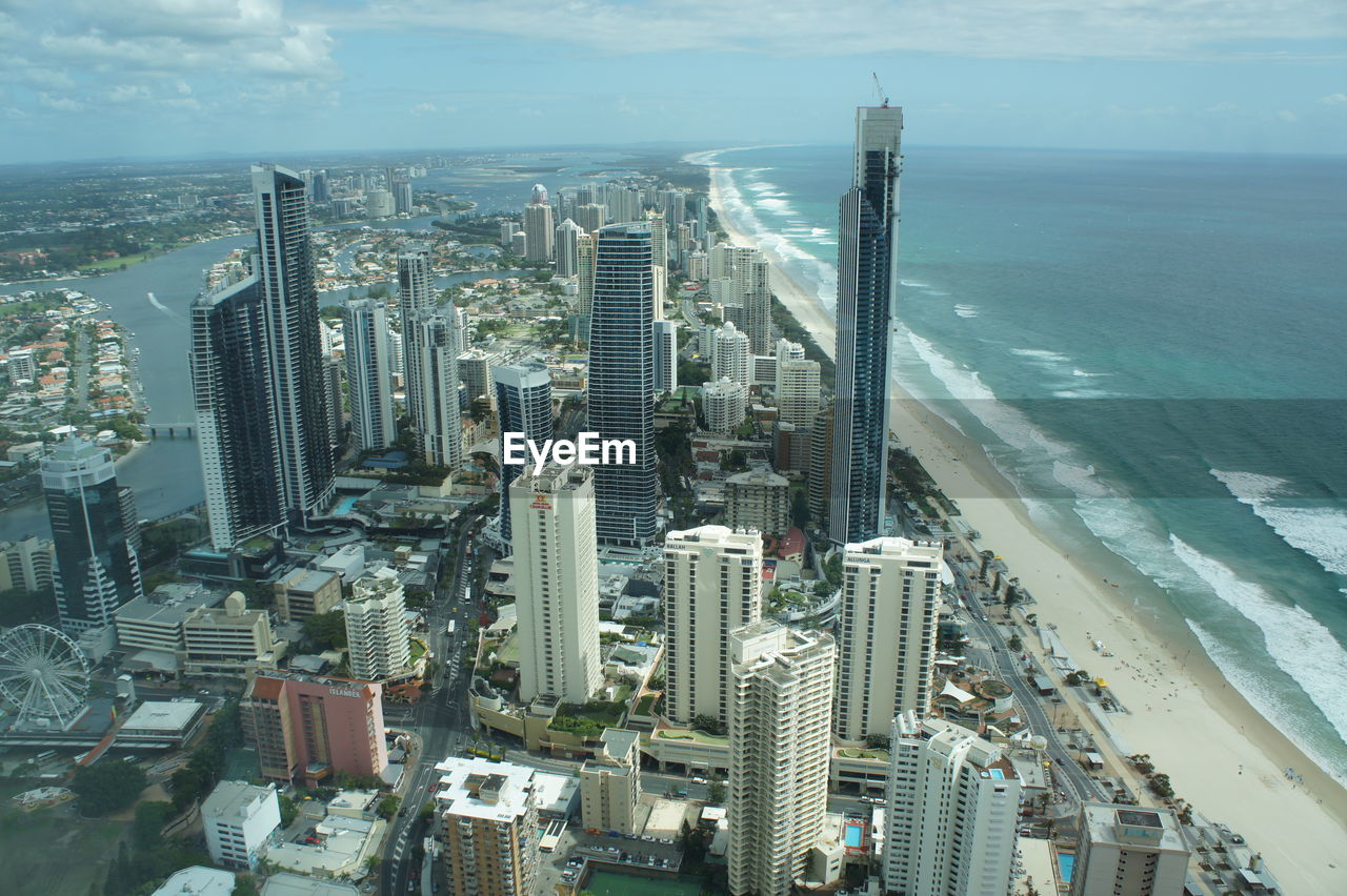 built structure, architecture, building exterior, water, city, skyscraper, office building exterior, cityscape, building, sky, sea, modern, tall - high, high angle view, no people, tower, horizon over water, nature, horizon, outdoors, financial district