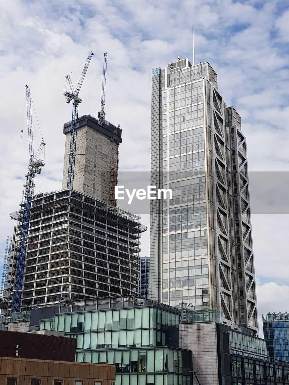 architecture, low angle view, building exterior, skyscraper, built structure, day, sky, cloud - sky, modern, no people, outdoors, city