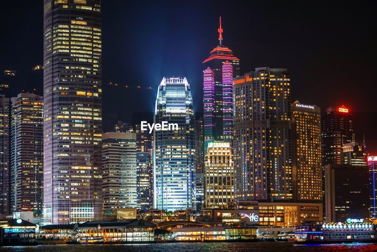 building exterior, architecture, built structure, night, illuminated, city, office building exterior, building, skyscraper, tall - high, modern, tower, office, cityscape, travel destinations, landscape, sky, urban skyline, no people, financial district, outdoors, spire, nightlife