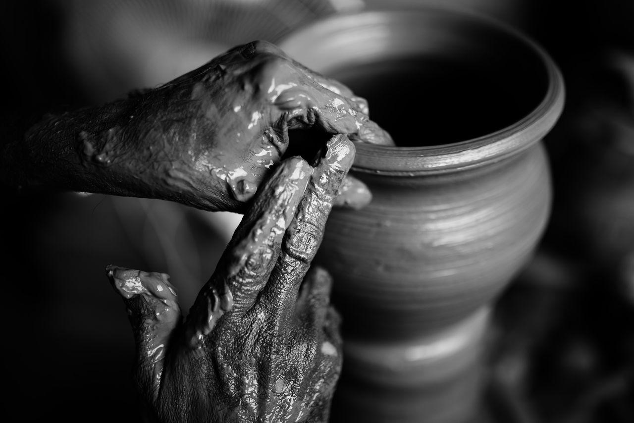 Cropped Hands Of Worker Making Pot At Workshop