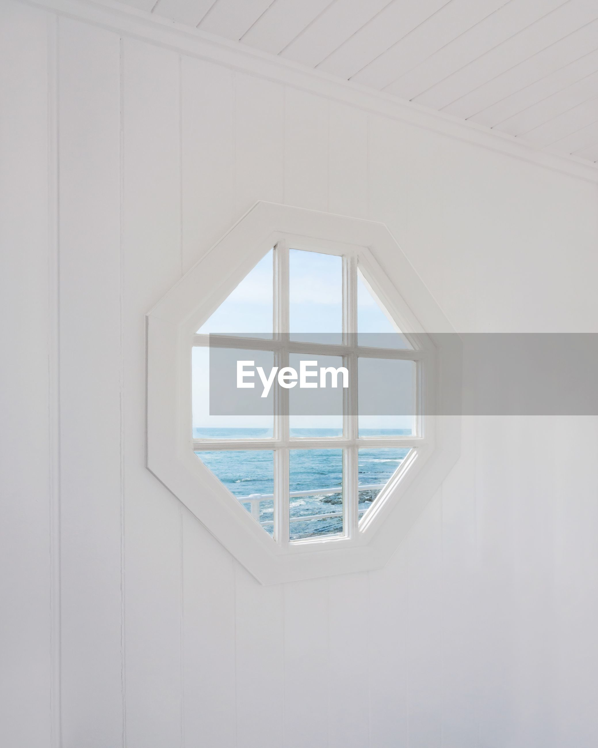 window, day, sea, architecture, glass - material, water, no people, nature, transparent, indoors, sky, built structure, white color, design, geometric shape, pattern, shape, horizon over water, window frame, ceiling