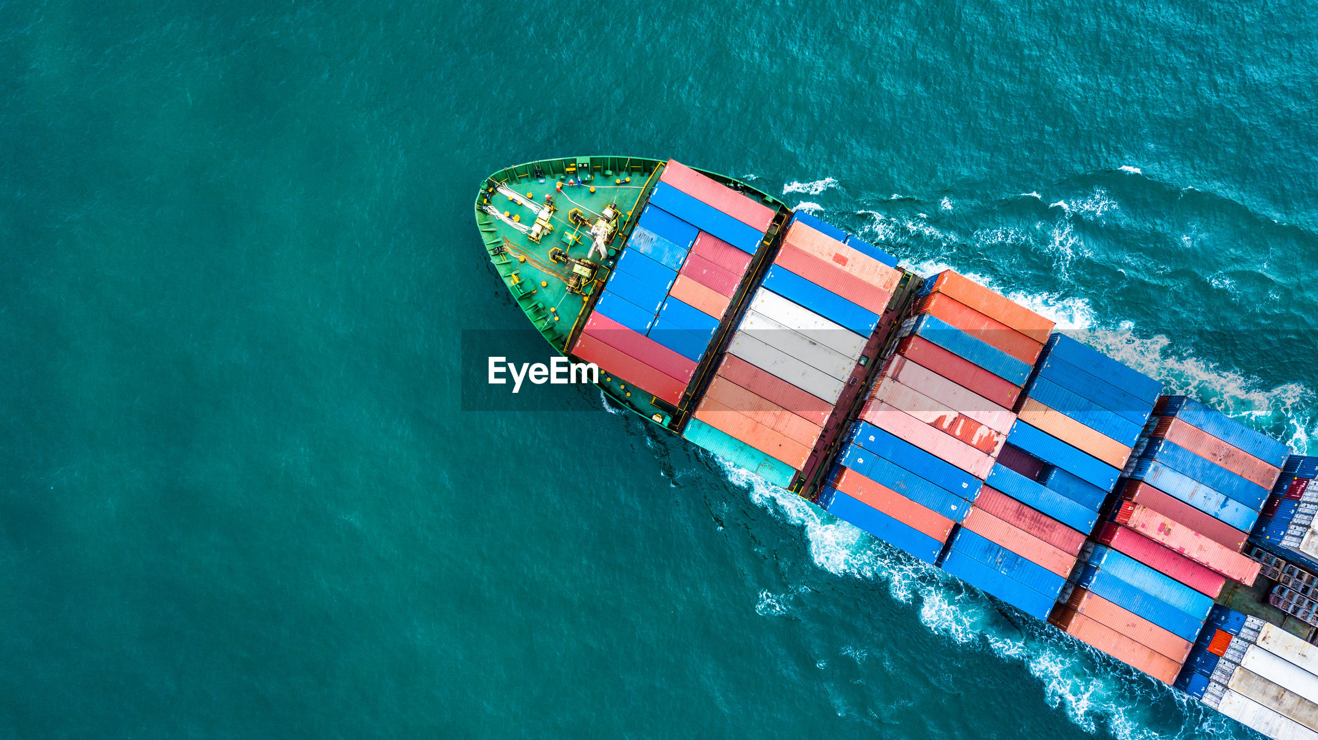 High angle view of cargo containers in ship sailing on sea