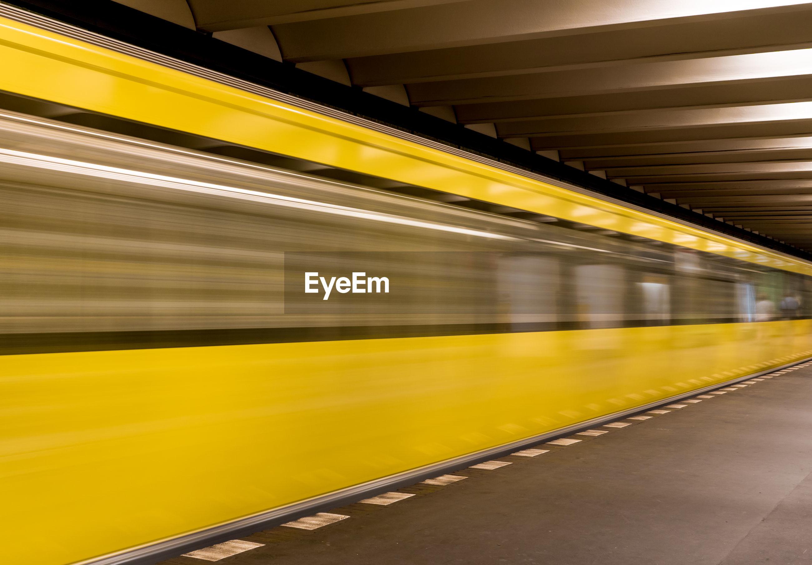 Blurred train at subway station