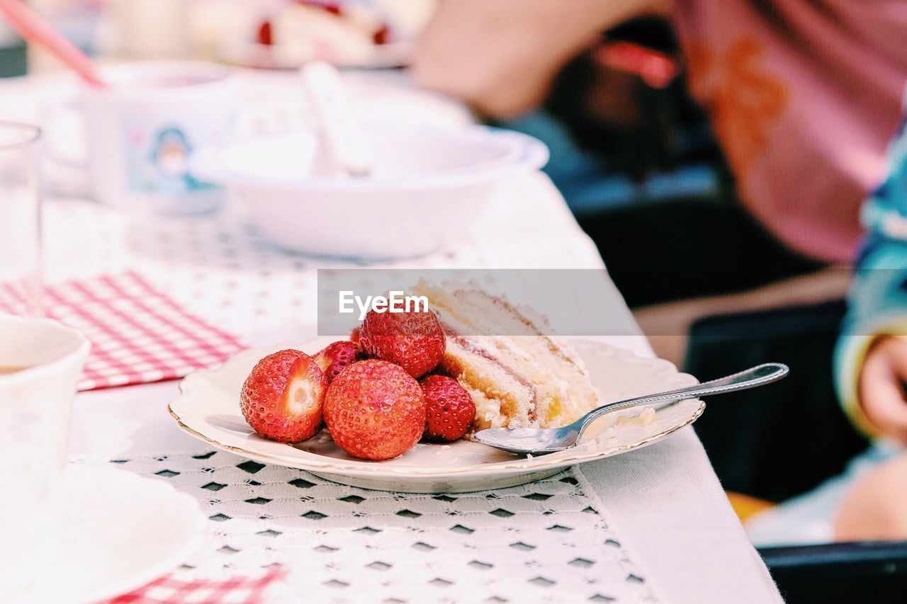 Strawberries In Plate On Table