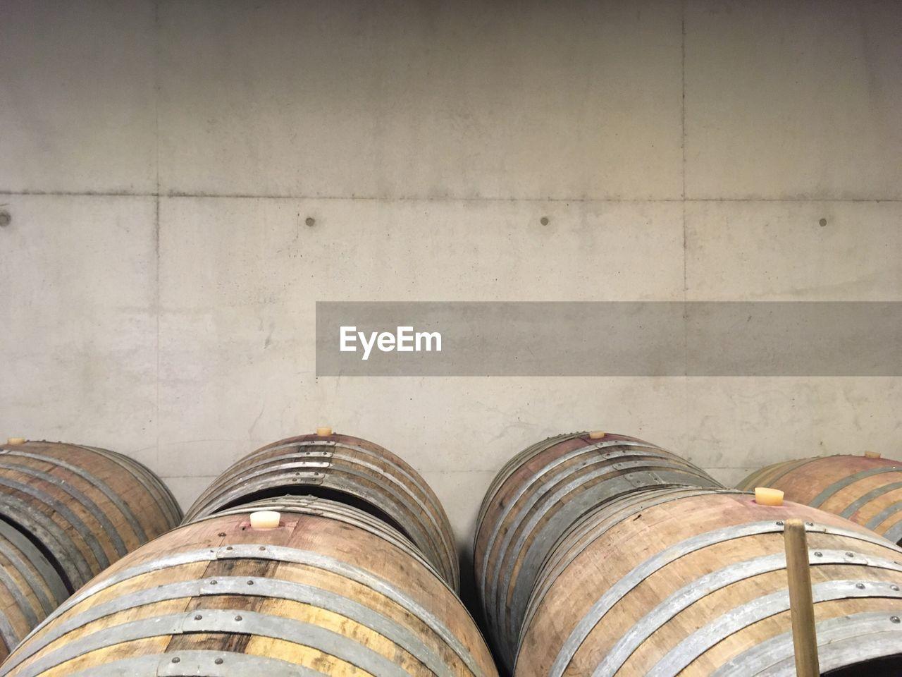 Barrels By Wall In Wine Cellar