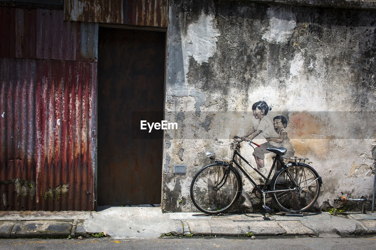 BICYCLE AGAINST WALL
