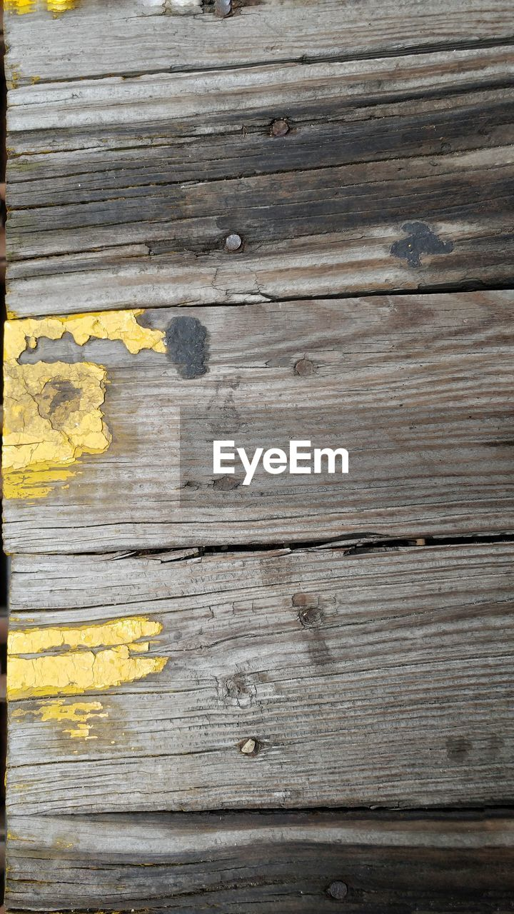 wood - material, old, backgrounds, pattern, striped, yellow, weathered, textured, dirty, rough, damaged, close-up, wood grain, timber, paint, no people, wood paneling, hardwood, outdoors, day