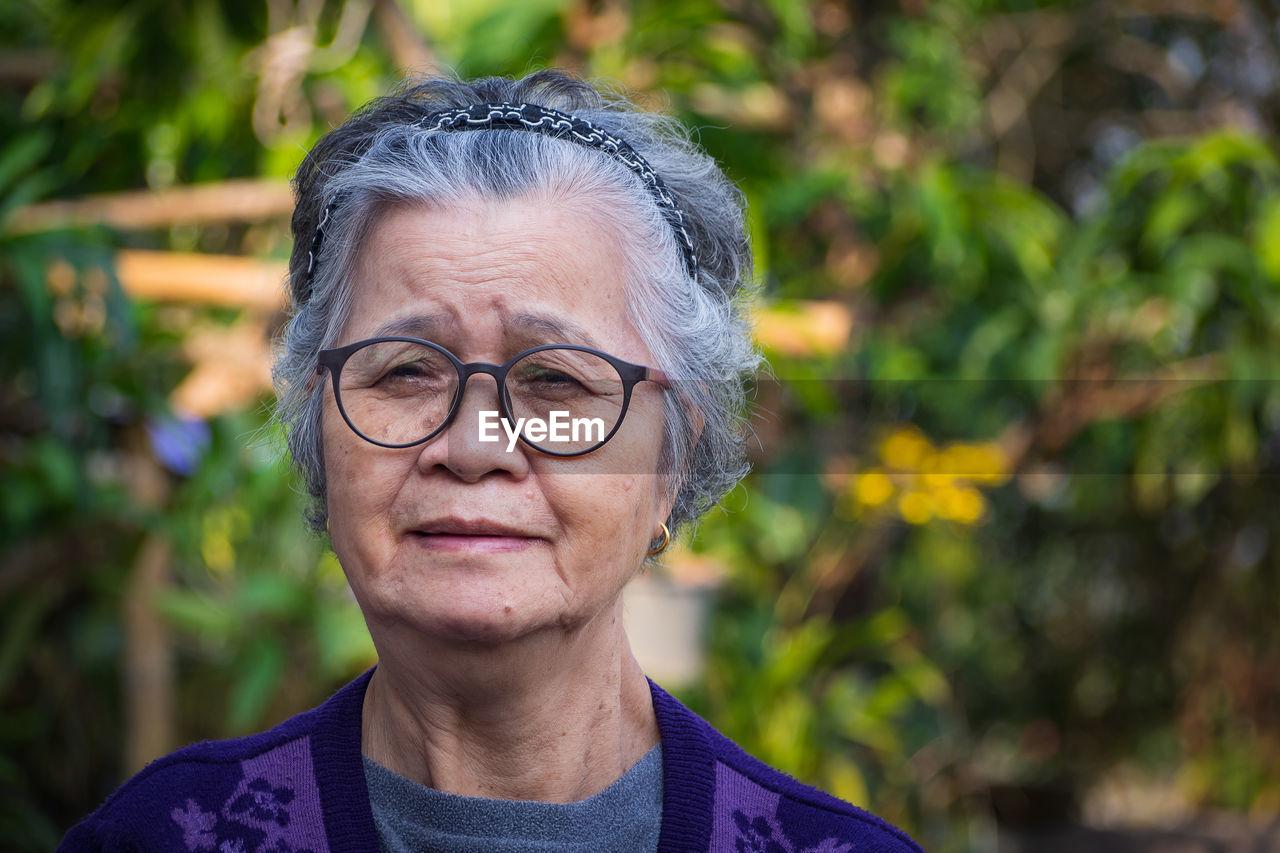 Portrait of elderly wearing eyeglasses