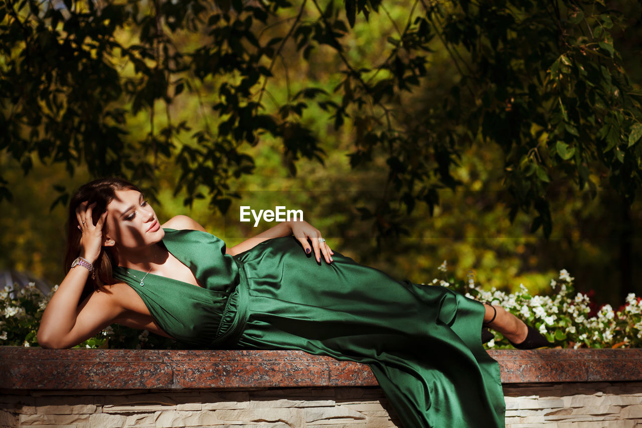 Full length of woman lying down outdoors