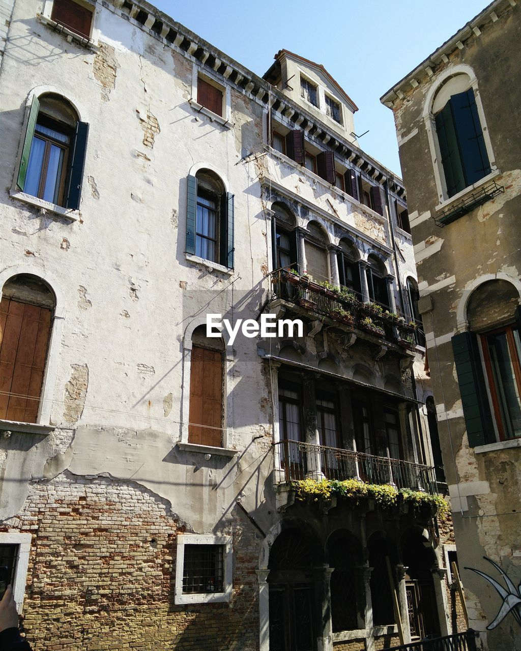 Low angle view of old buildings in town