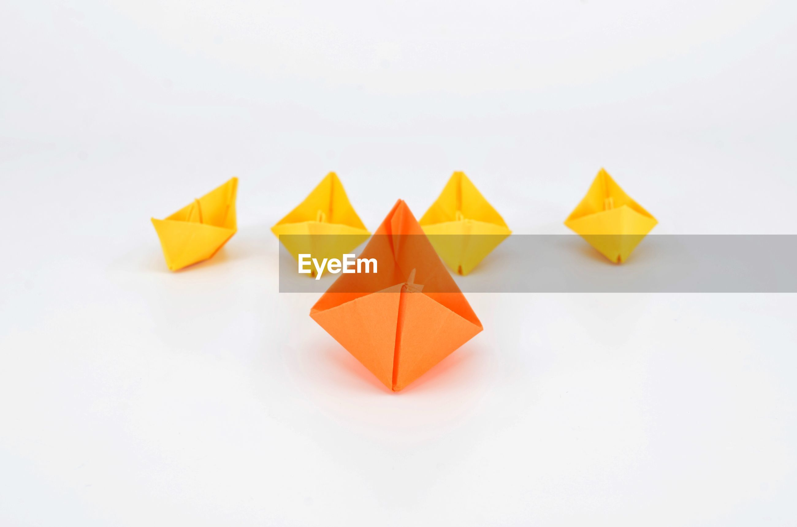 High angle view of paper boats on white background