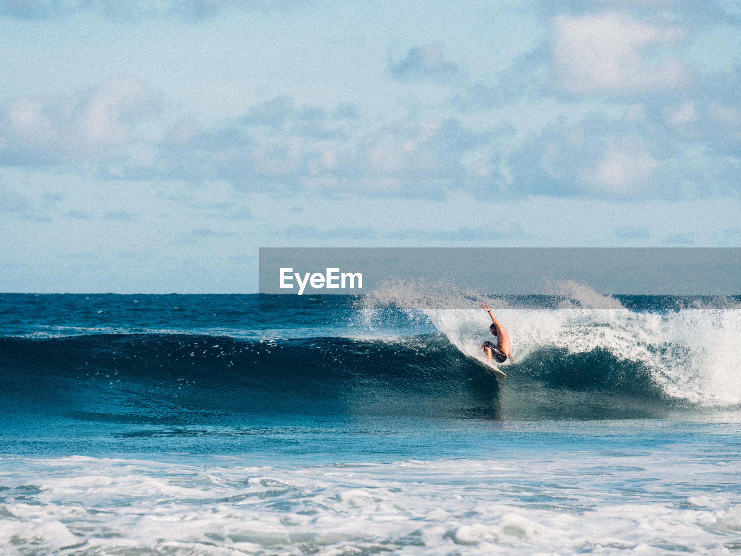 Man surfing at beach